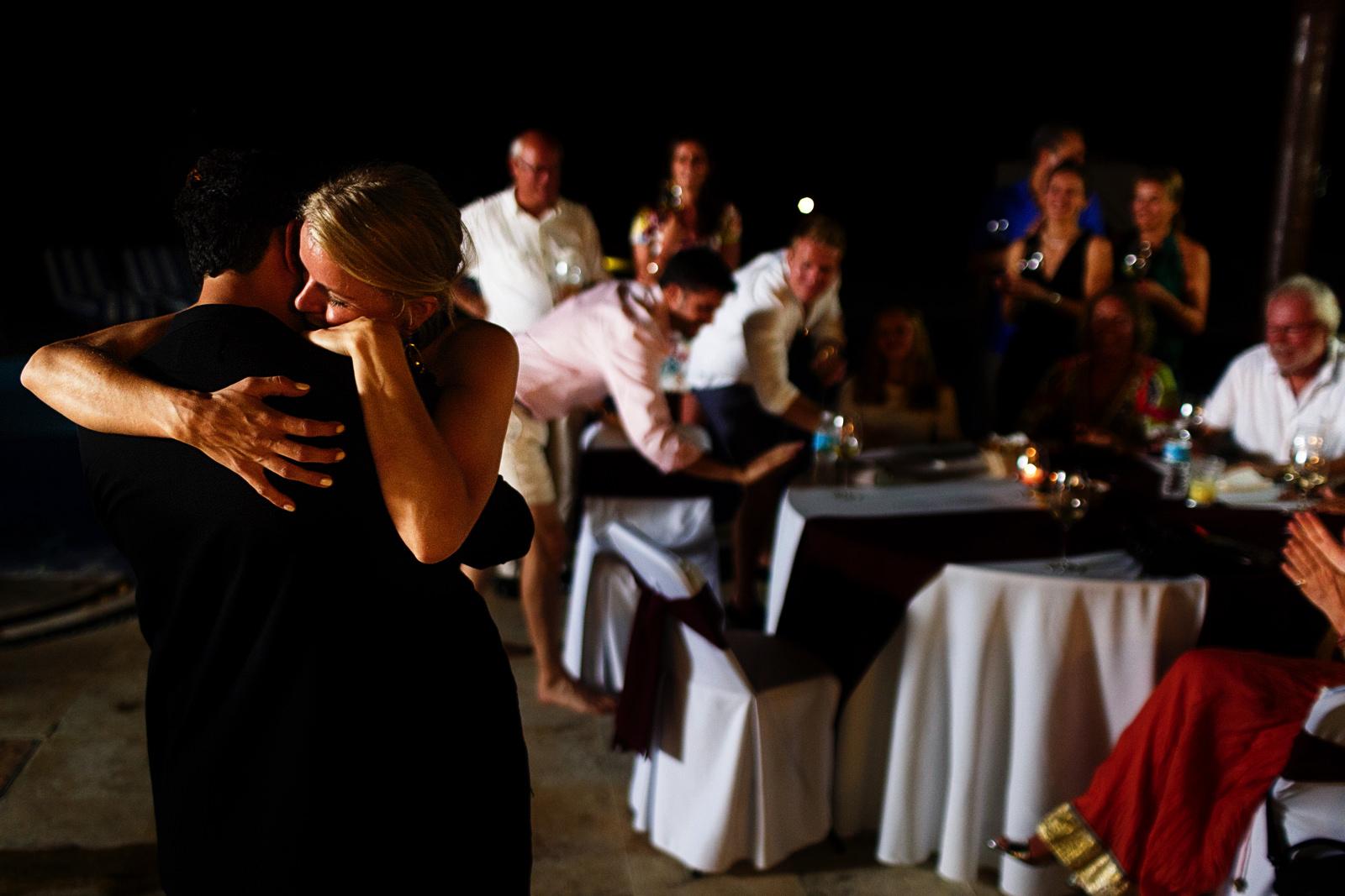 Bride hugs groom after his speech