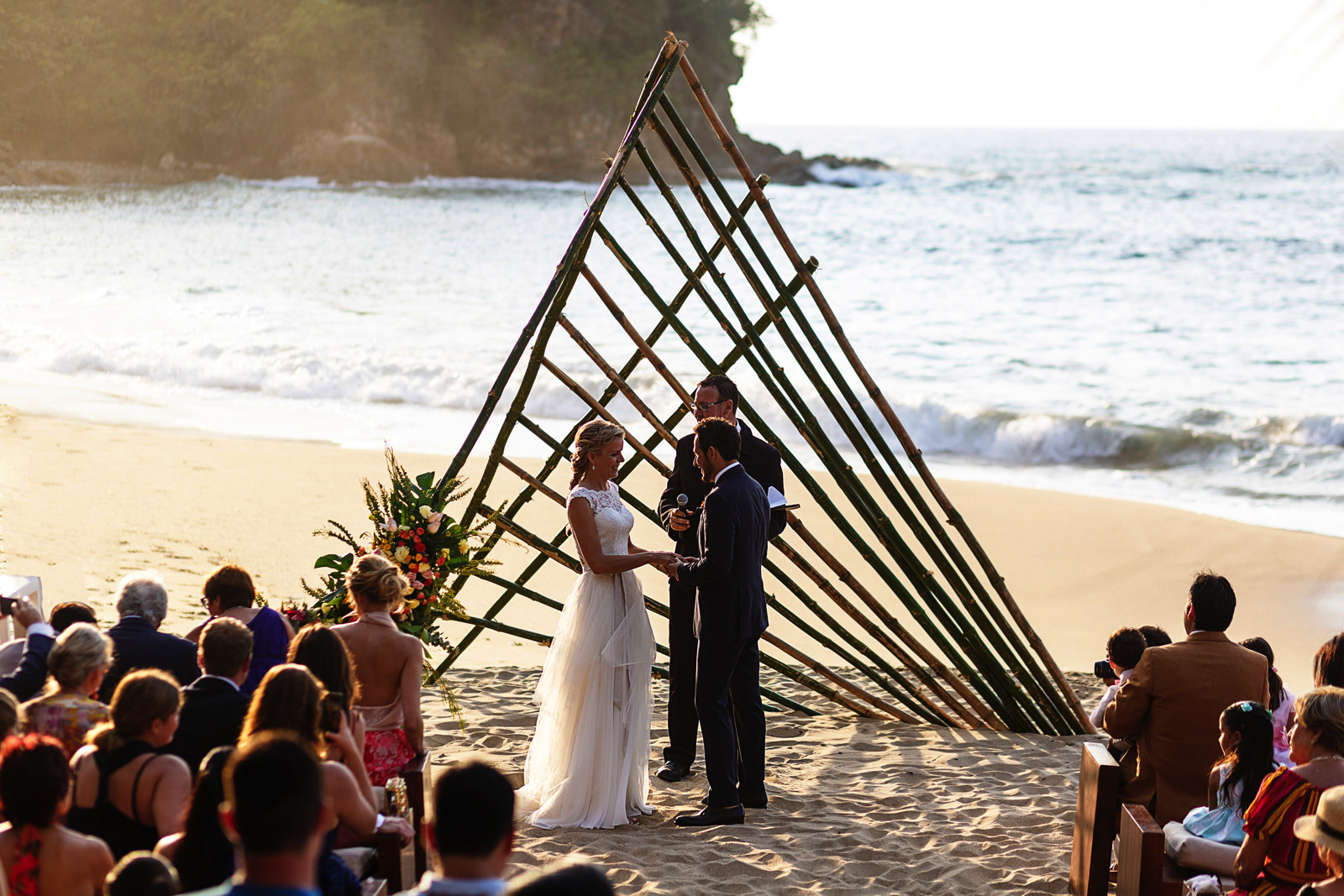 Wedding ceremony on the beach vows exchange in progress