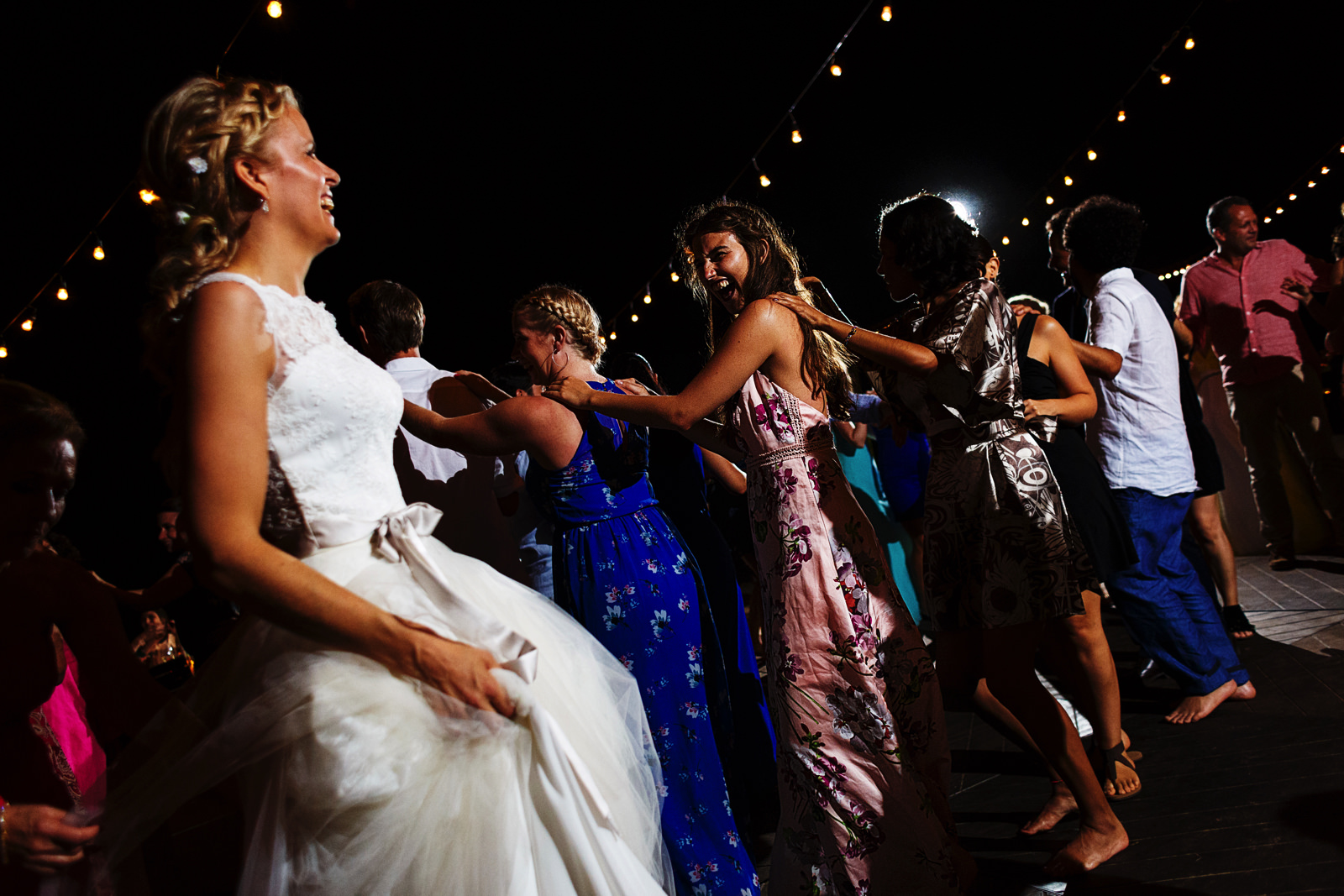 Conga line during the party of the wedding with the bride leading everyone