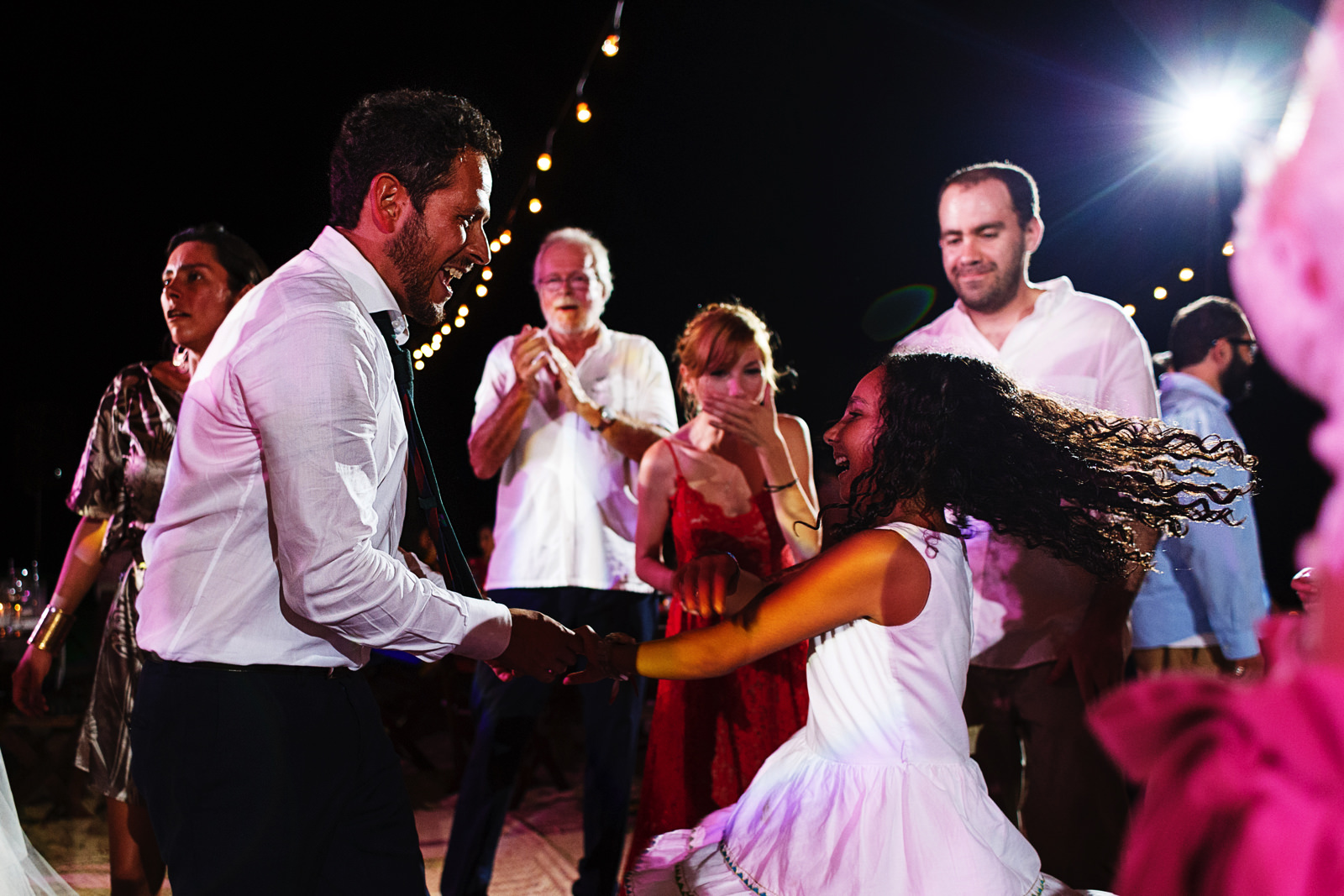 Groom dances with a young girl