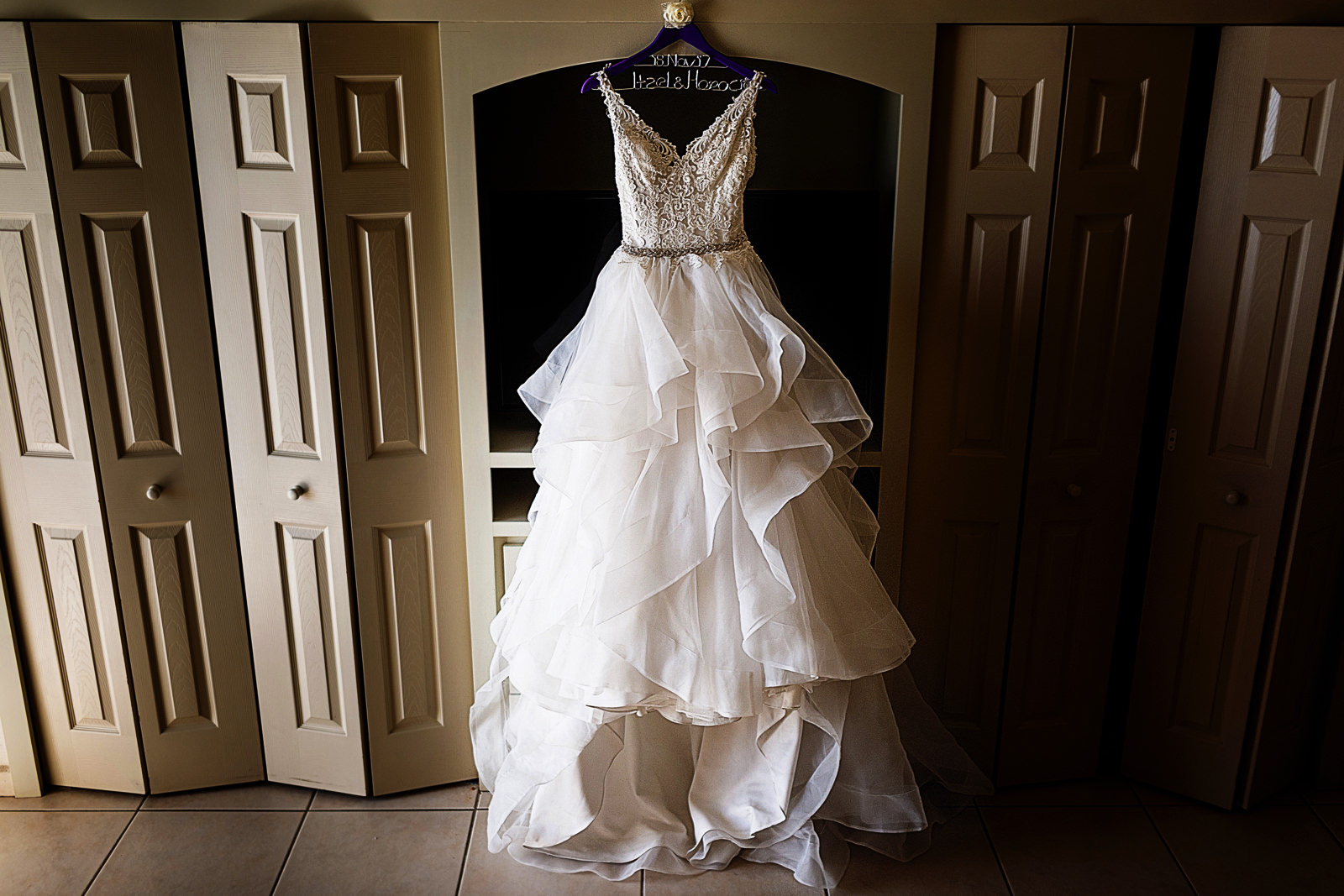 Wedding dress hanging in the room by itself