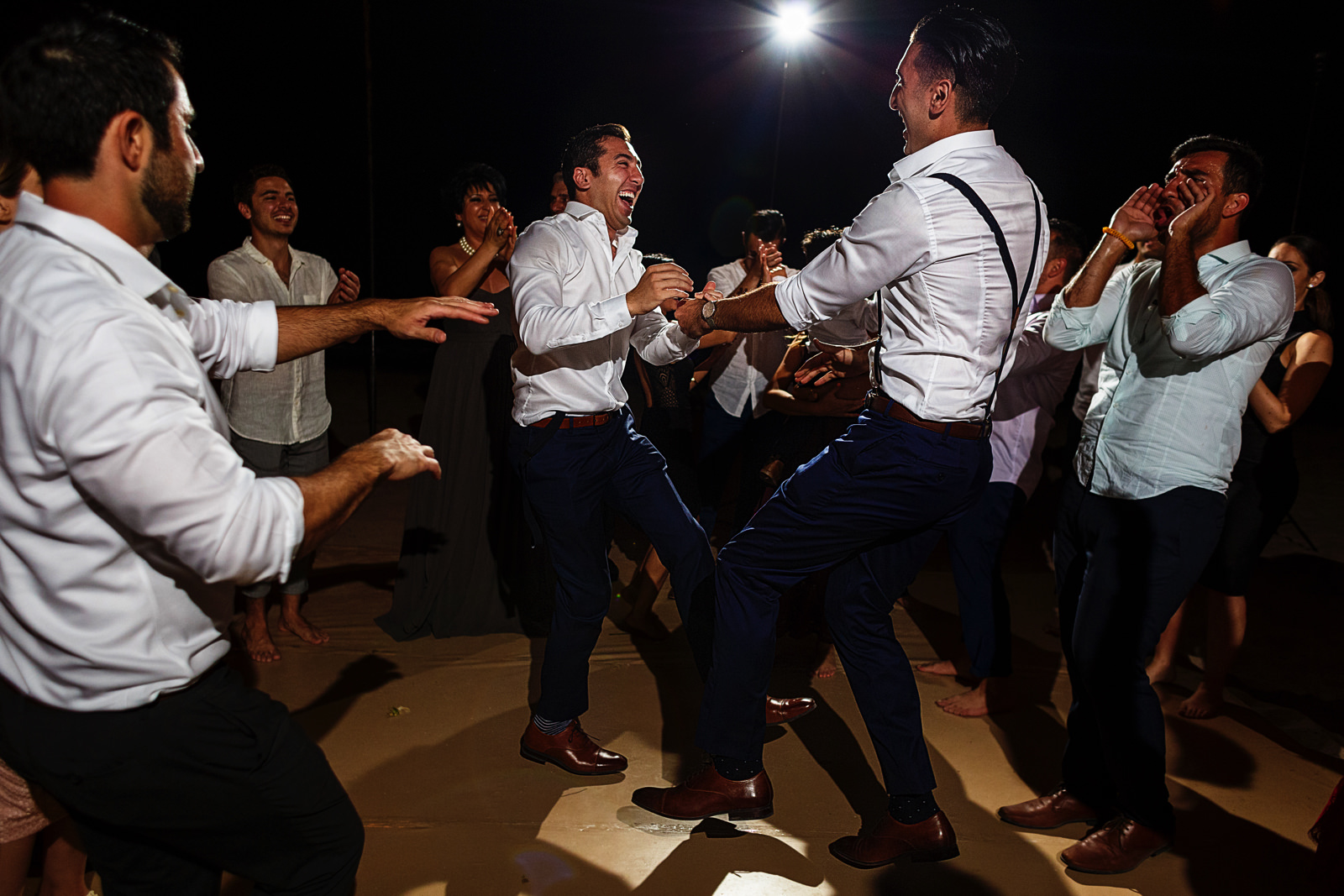 Groom and best-man dancing in one leg at the wedding party