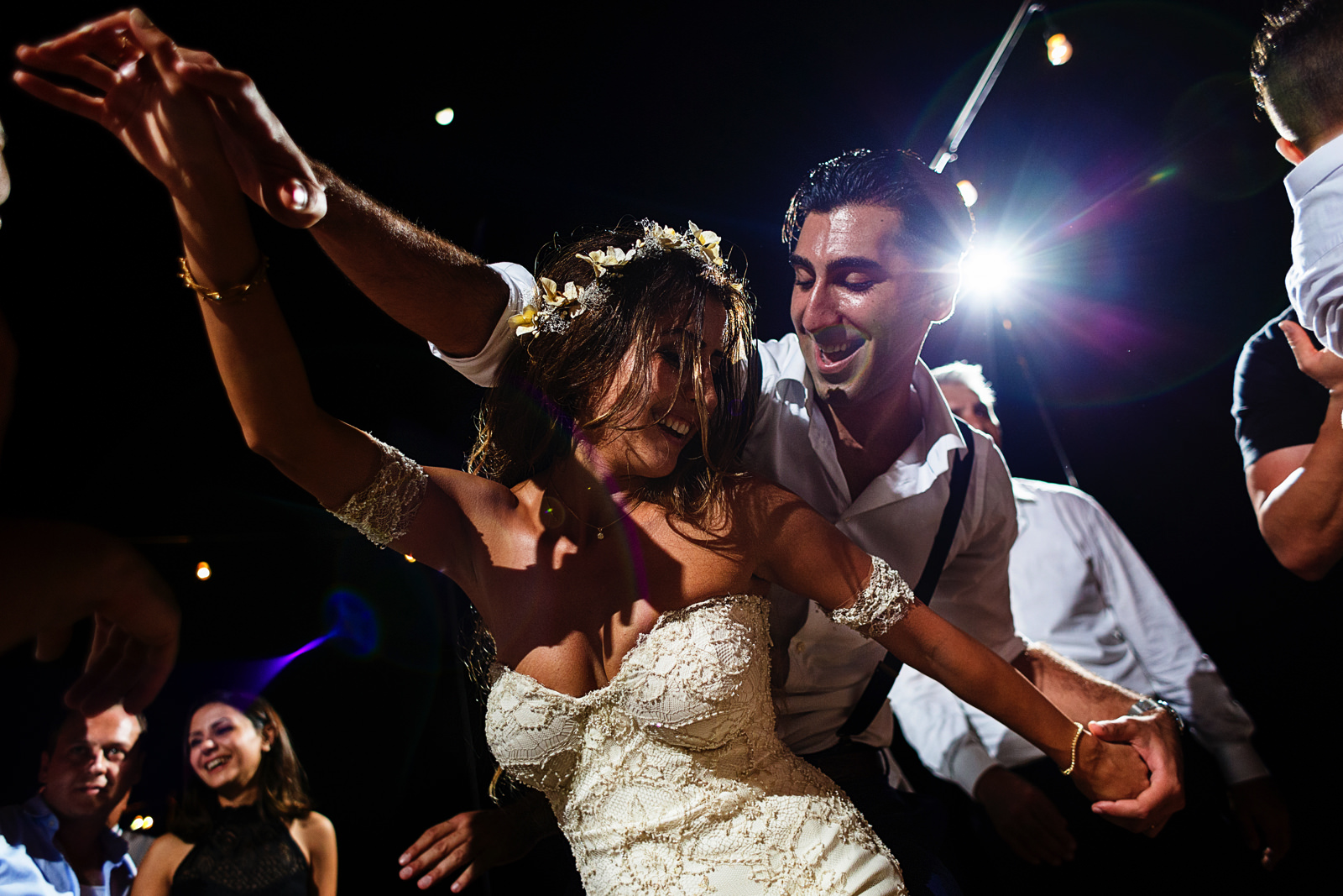 Bride and groom showing their best moves in the dance floor to all of their wedding guests