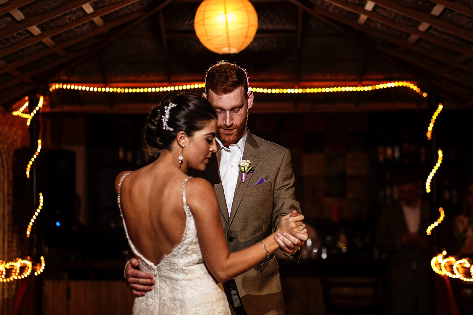 first-dance-groom-bride-palapa-ceiling-tied-lights.jpg