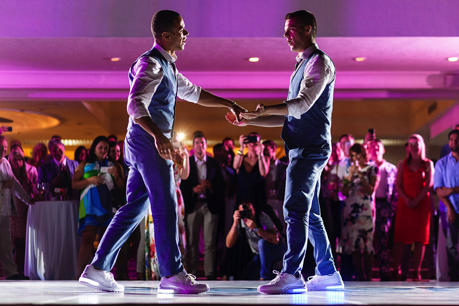 Grooms giving it all during their coreographed wedding first dance