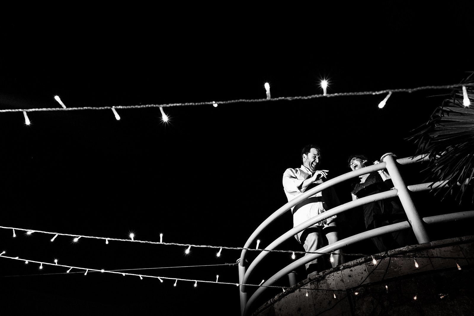 Wedding guests dancing and having a good time on the top of a staircase