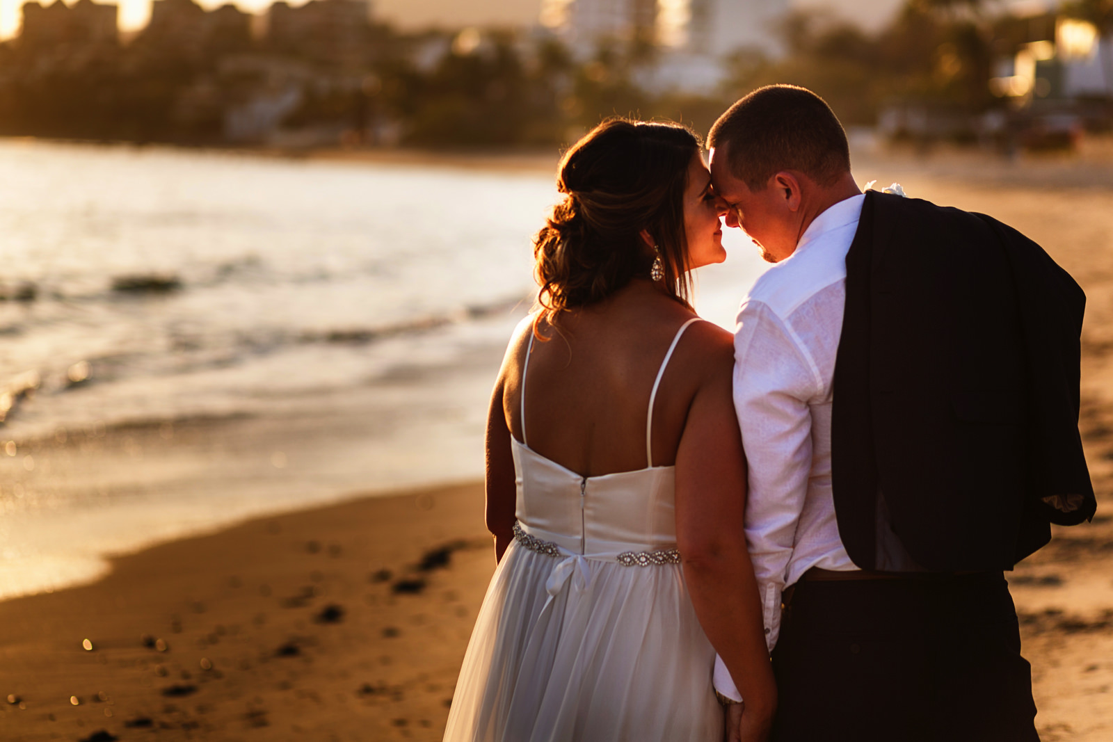 Bride and groom portrait with backlight from the sun