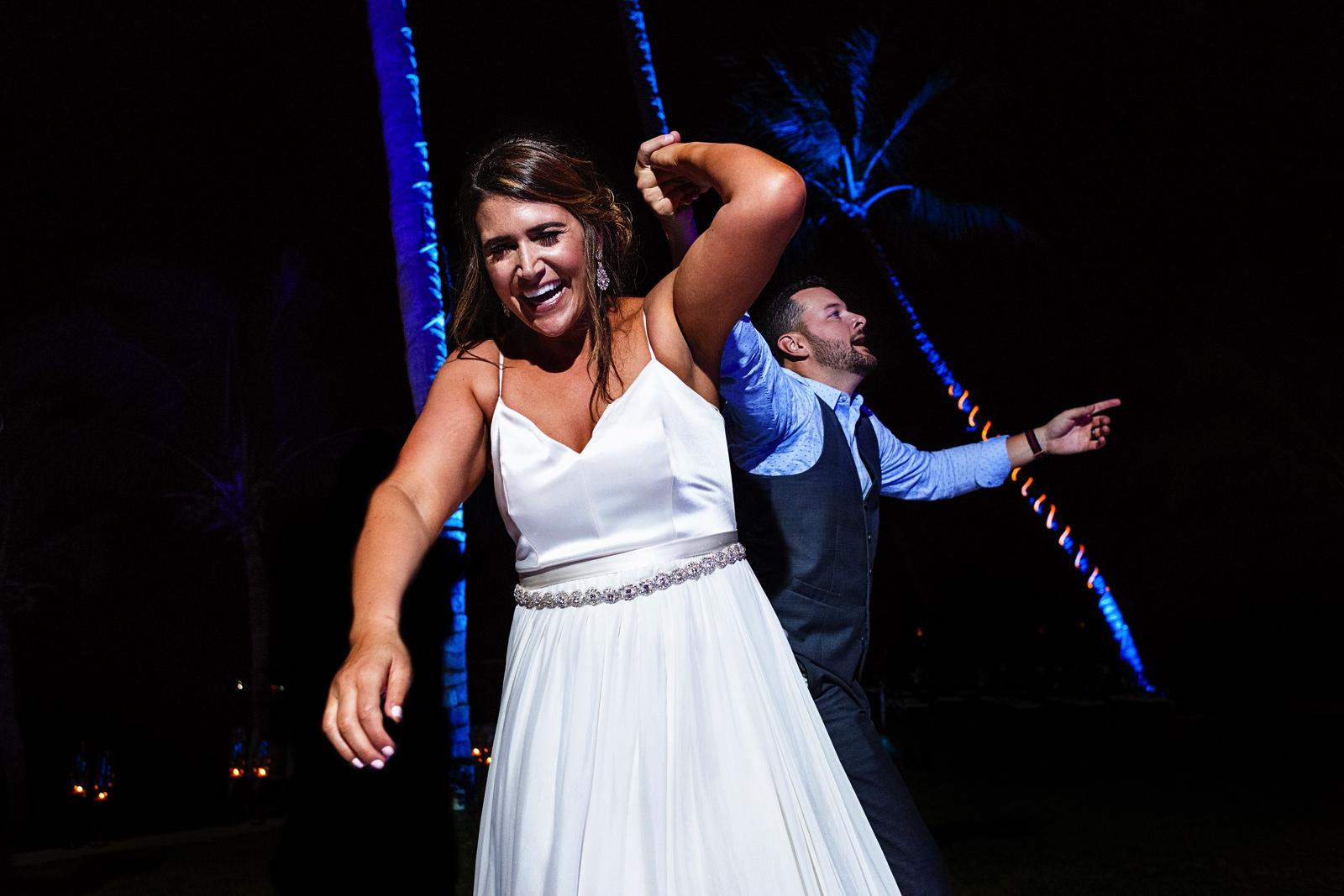 Bride and wedding guest dancing and having fun