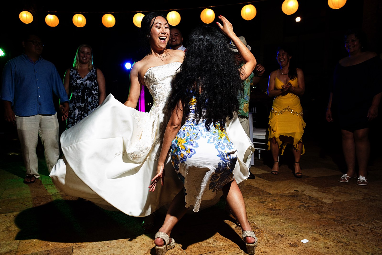 Bride dancing with a wedding guest