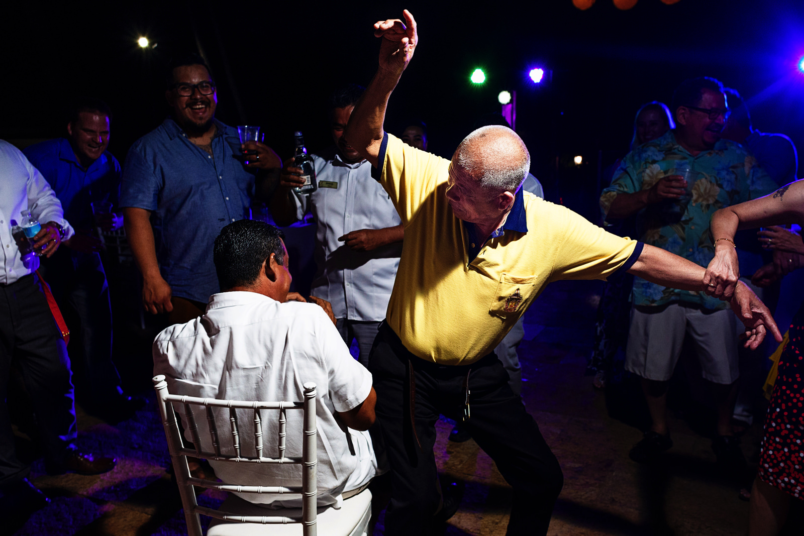 Father of the bride trying to do a lap dance as he is being controlled by his wife