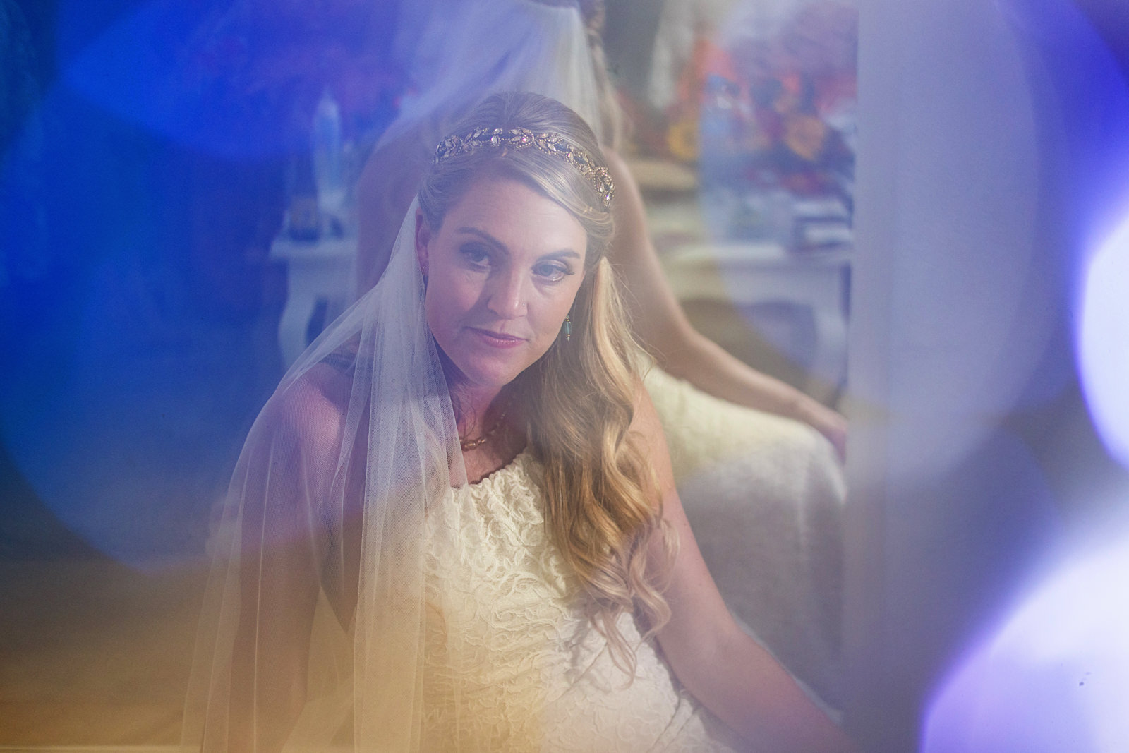 Bride's portrait through colored lens flare