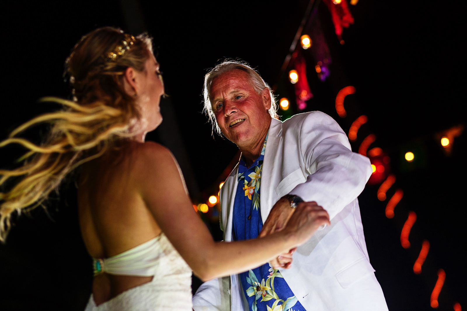 Father spins the bride during the dad and daughter dance