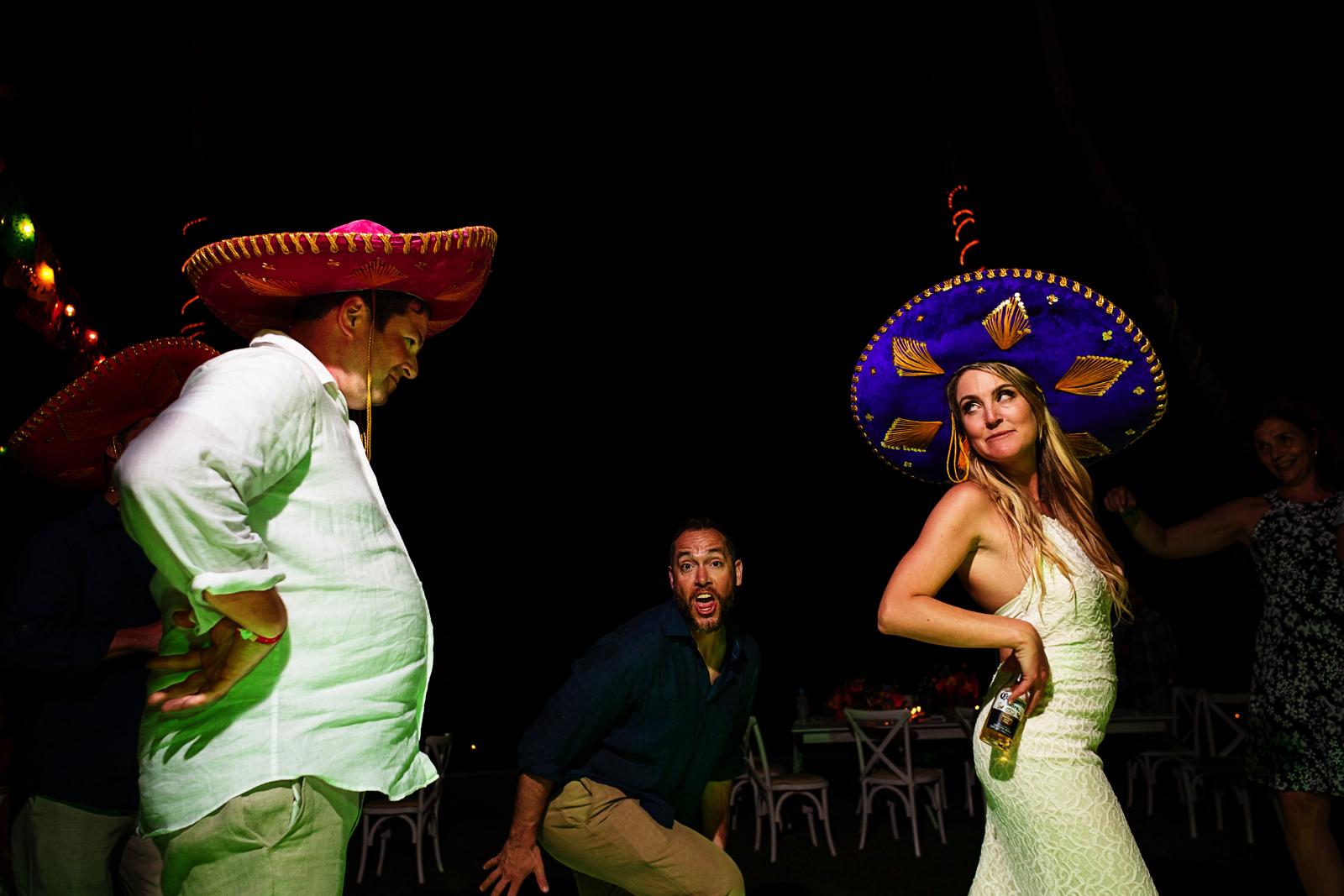 Sombrero dancing battle between the bride and a wedding guest