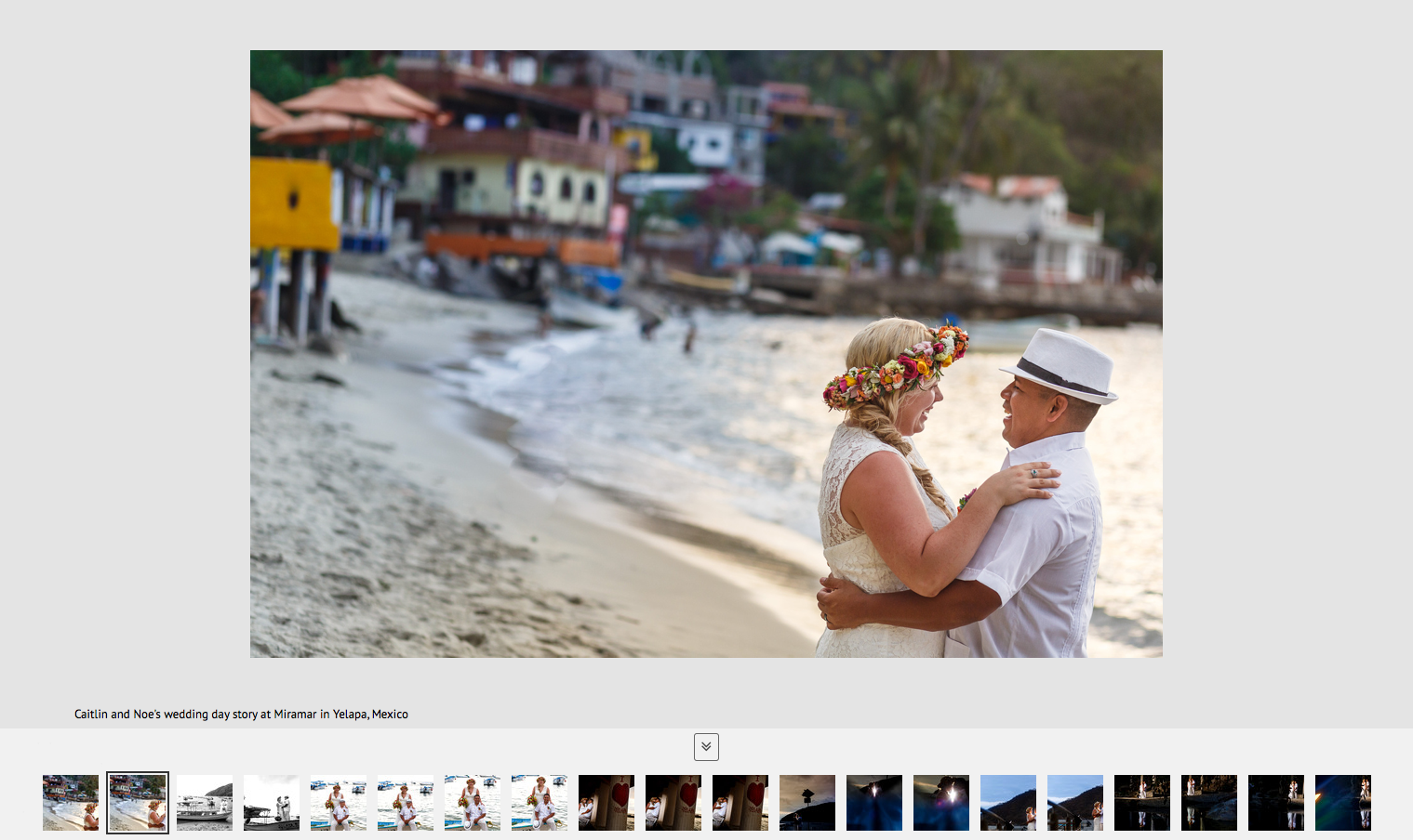 Bride and groom smiling at each other on the beach near Miramar hotel in Yelapa, Mexico.