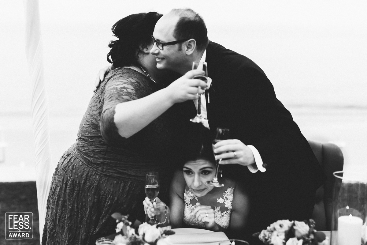 Groom and sister-in-law hugging and squishing the bride between them - Fearless Award by Eder Acevedo.