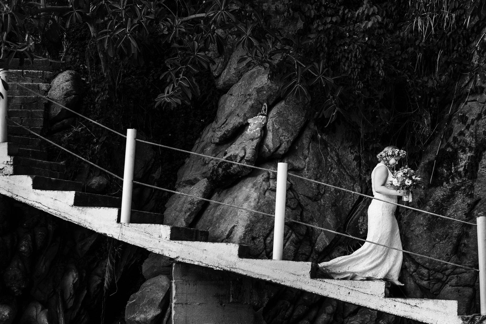 Bride going down the stairs of Miramar Yelapa.