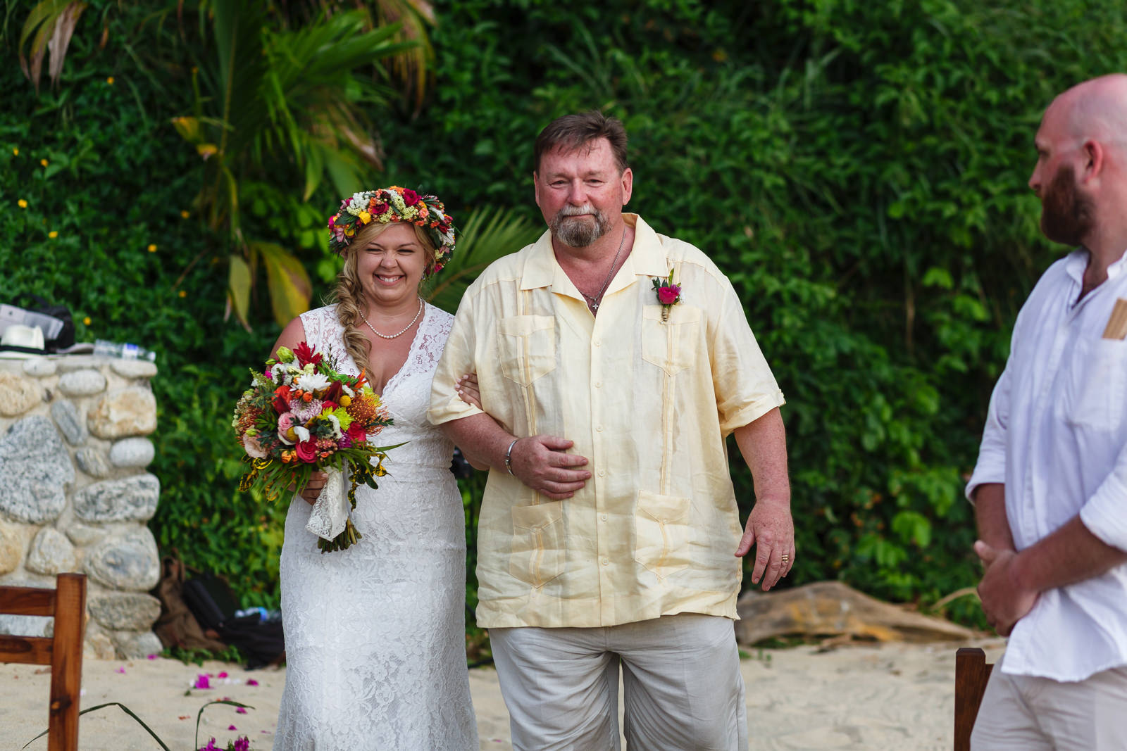 Bride walking with her dad down the aisle.