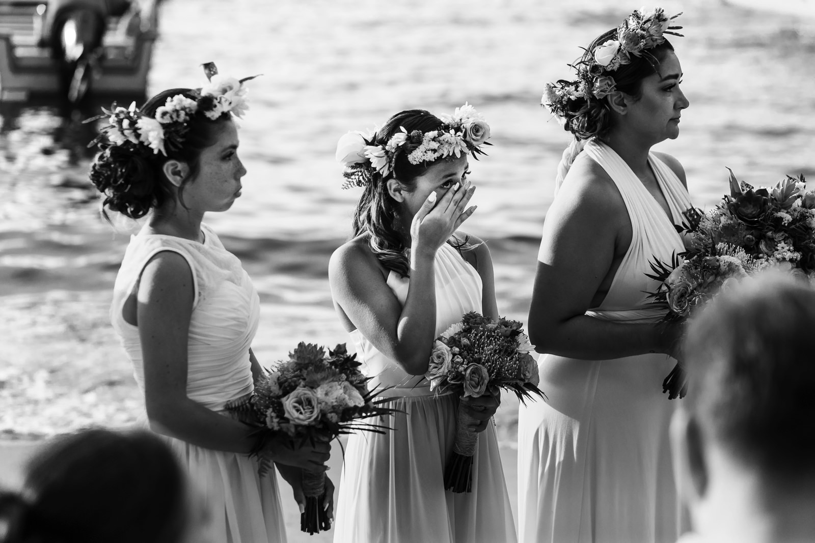 Bridesmaid/daughter crying during the wedding ceremony on the beach at Miramar Yelapa.