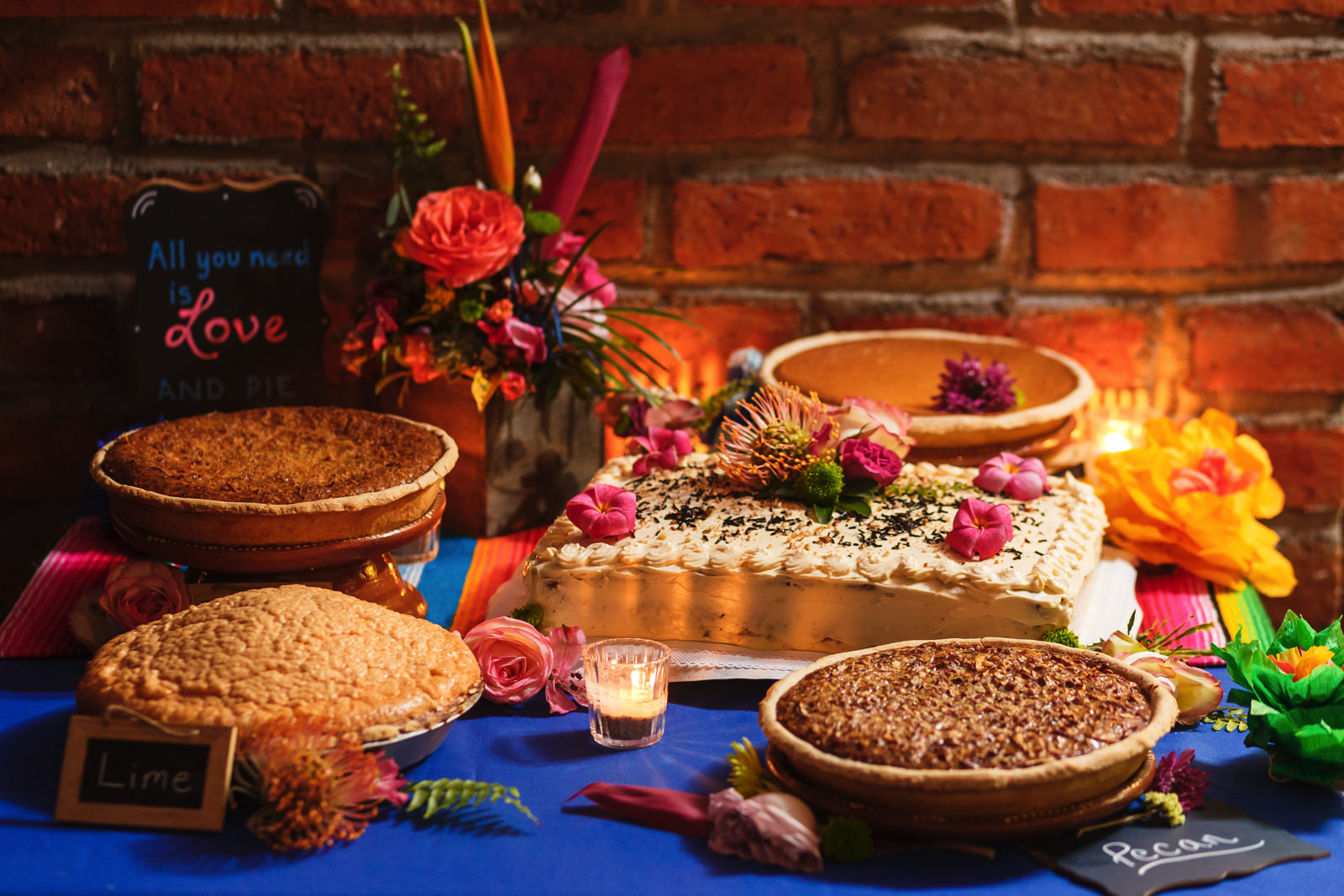 The collection of all of the famous pies from Yelapa, next to the wedding cake.