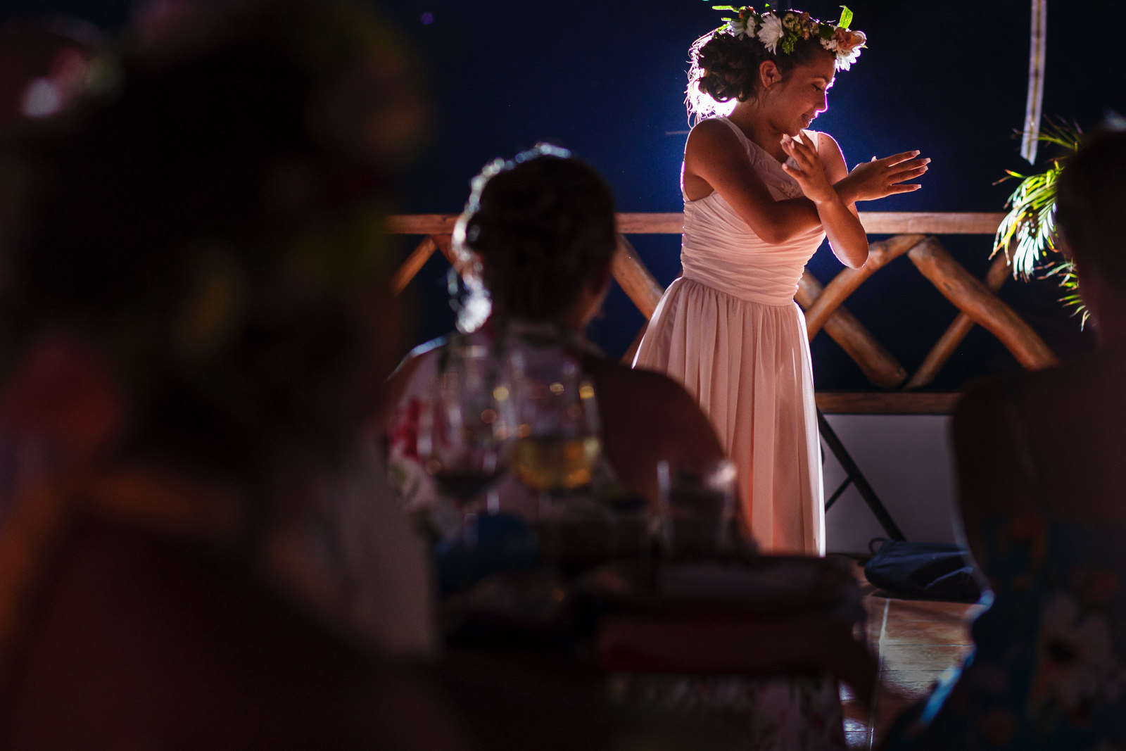 Bridesmaid/daughter performing a dance during the wedding dinner.