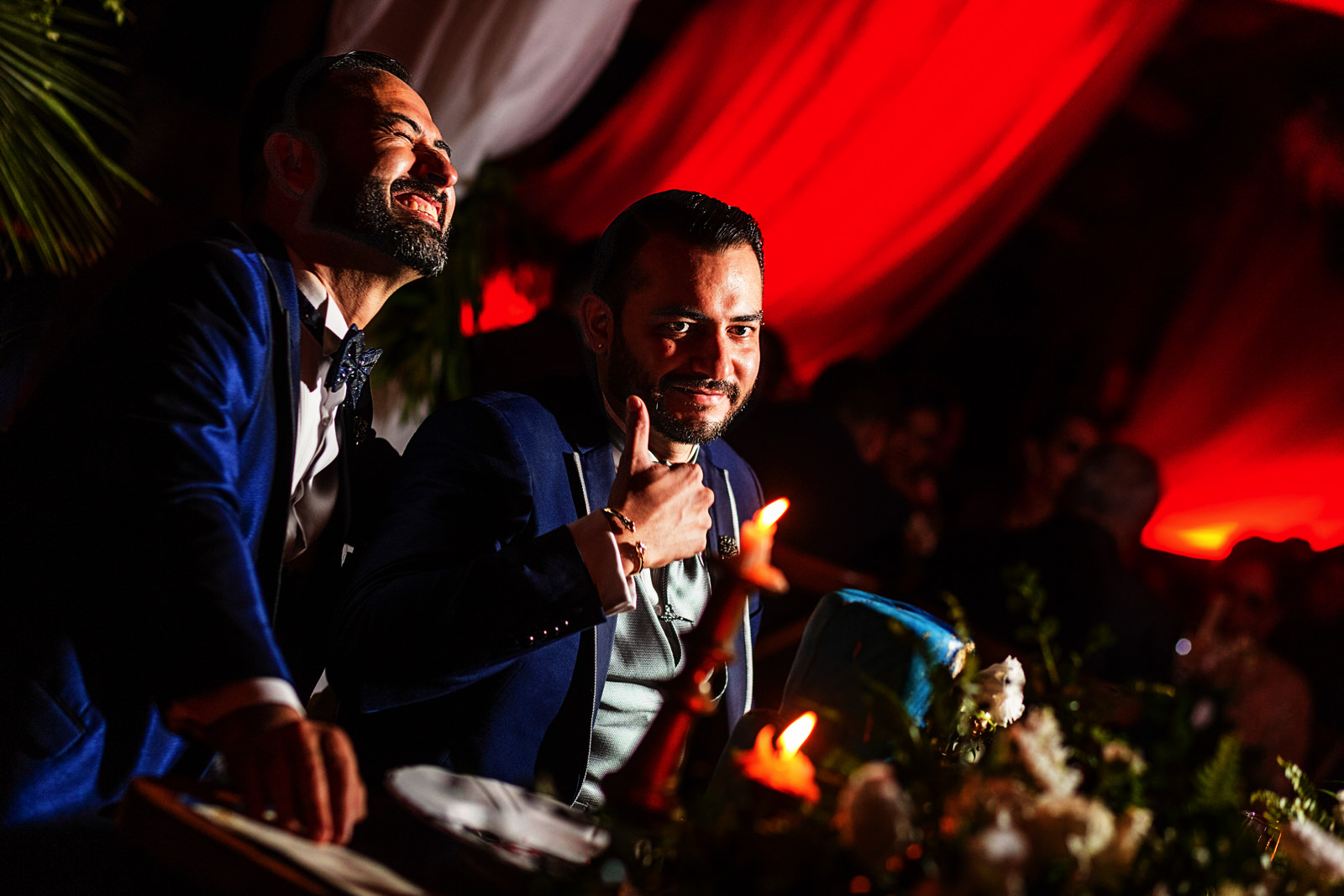 Gay couple on their dinning table during the speeches.