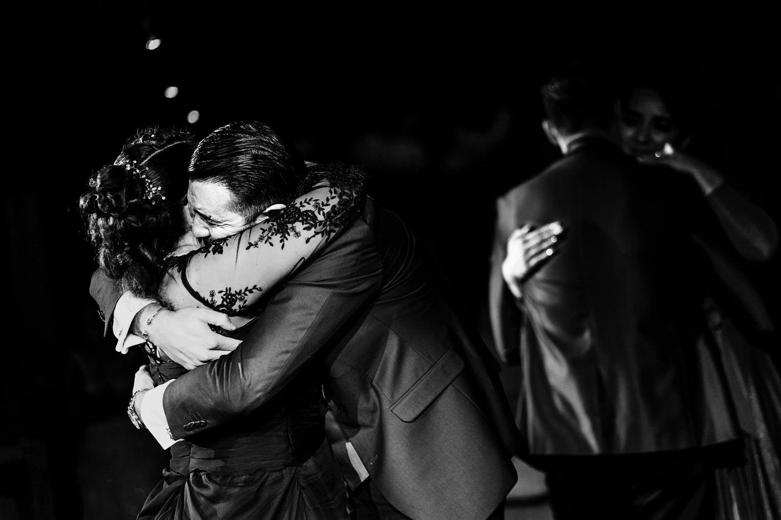 Groom and mother hugging during mother and son dance.