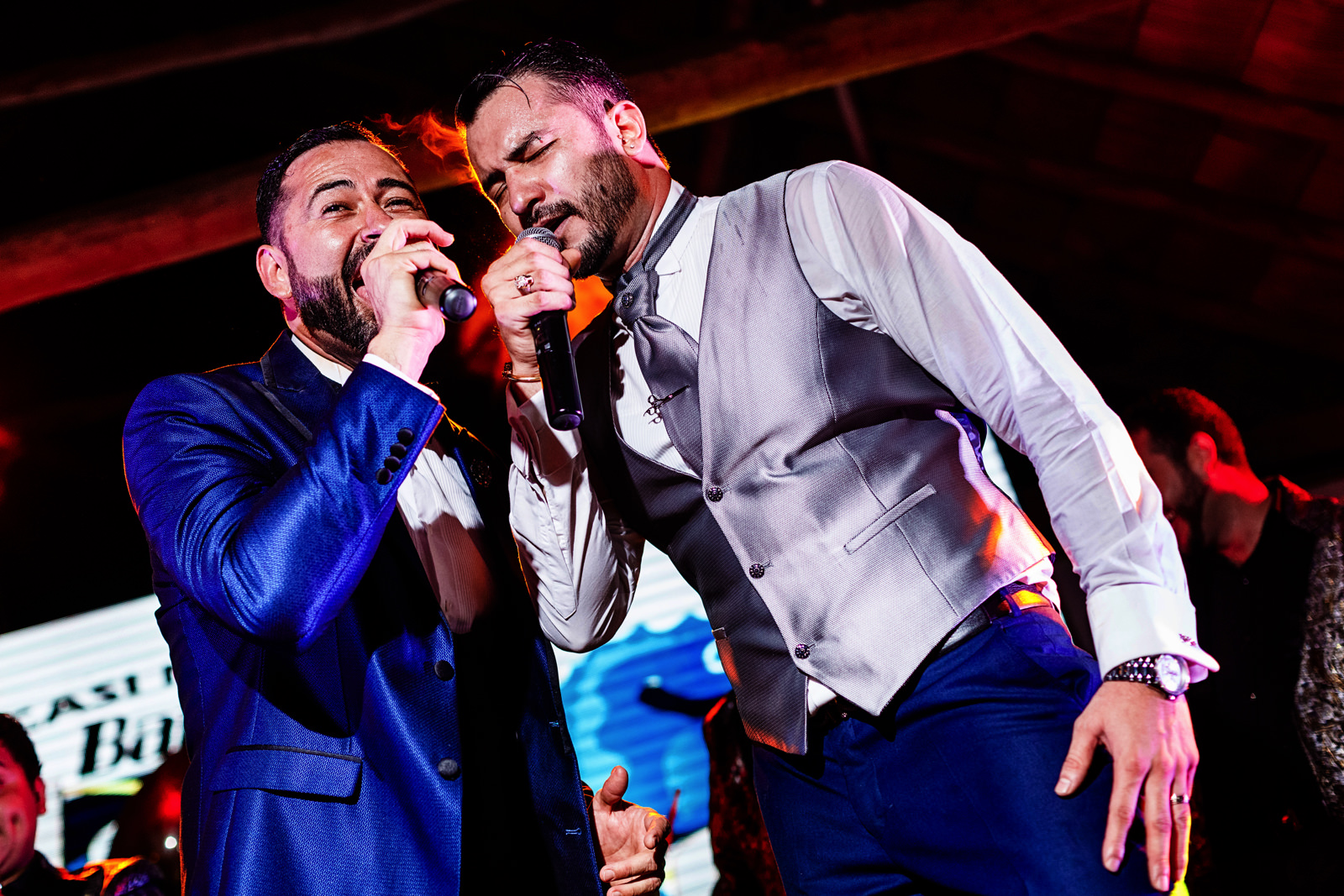 Grooms singing on the stage.