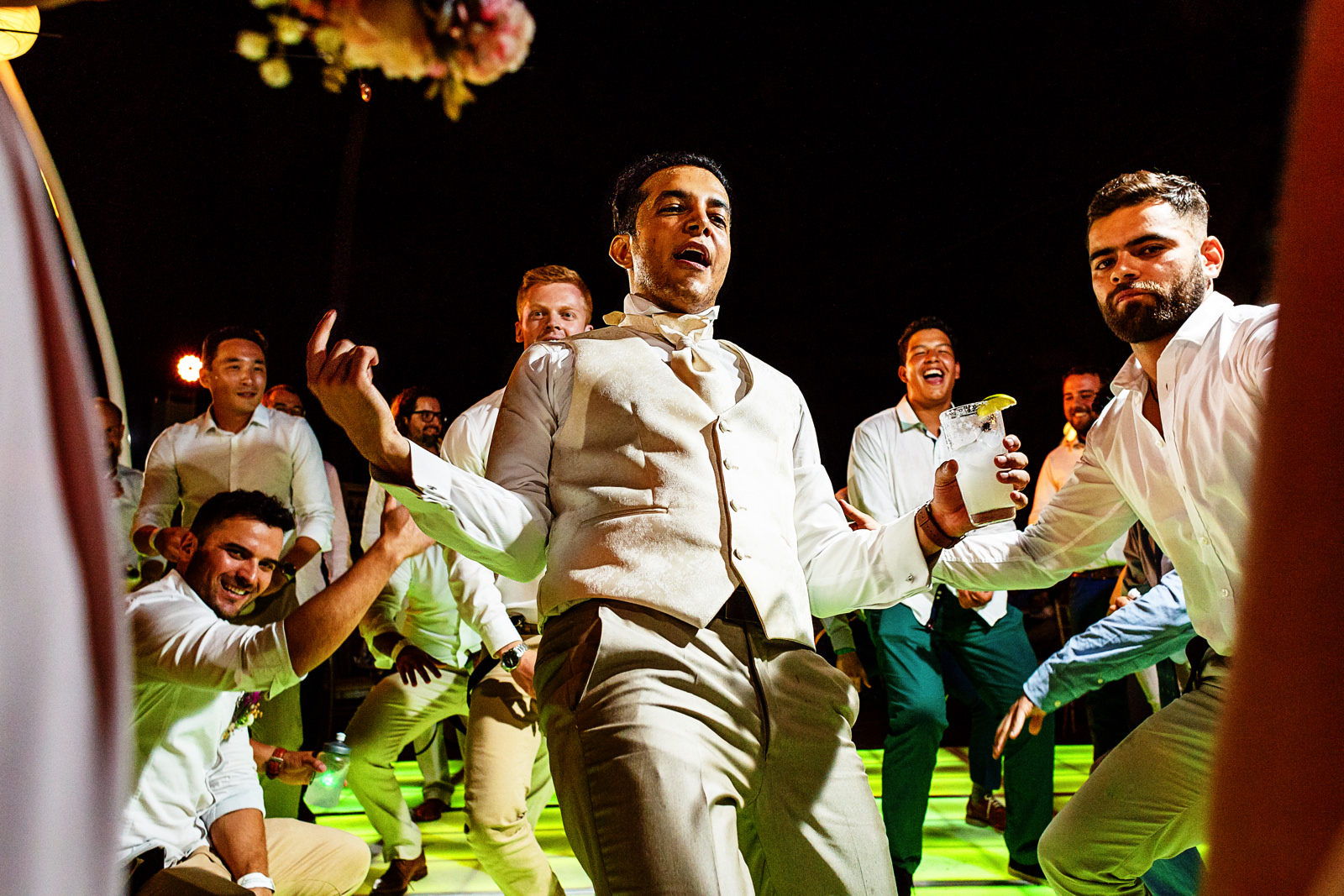 Groom and his gang giving it all in the dance floor for a dance battle.