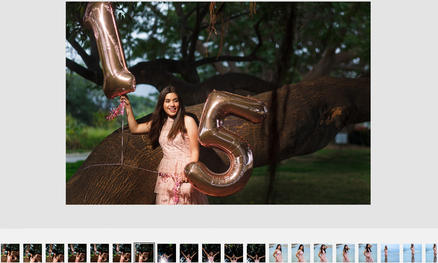 "Fifteen years old girl holding ""15"" shaped balloons leaning on a tree in Puerto Vallarta."
