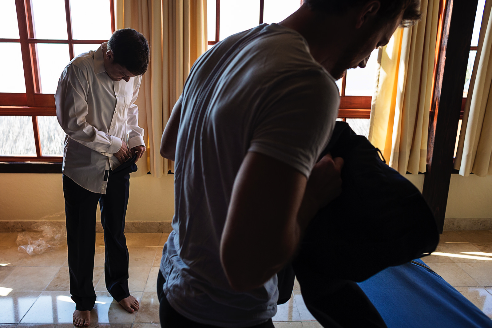 groom-getting-dressed-groomsman-playa-fiesta-wedding.jpg