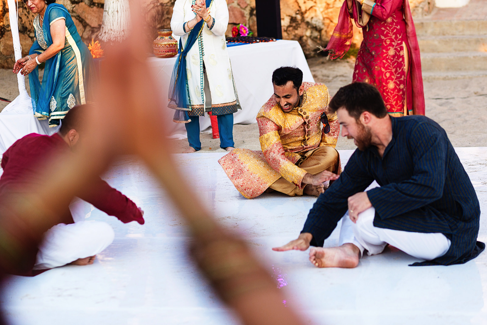 Groom and groomsmen perform for family and friends at hindu traditional party