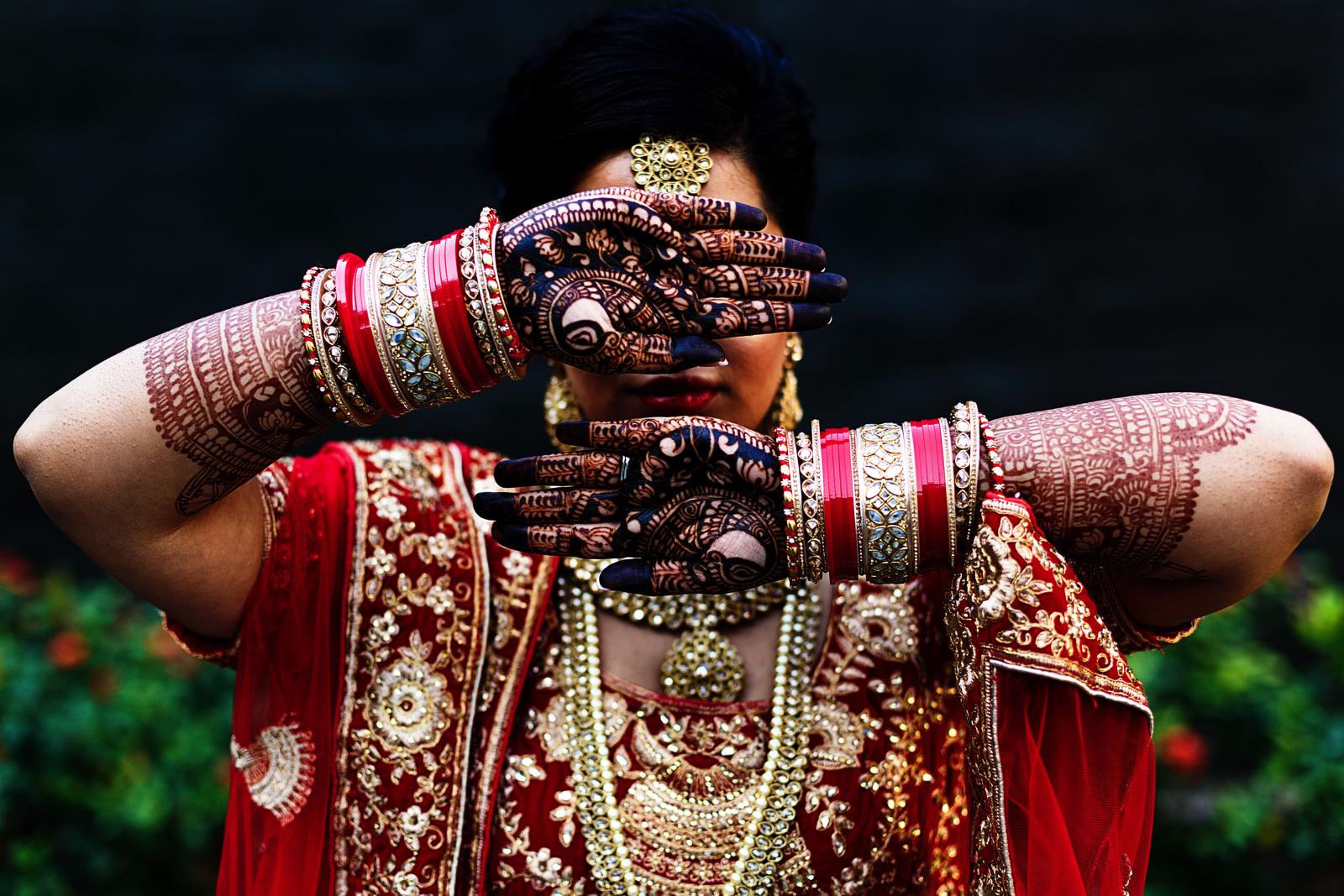 Hindu bride shows her henna tattooed hands
