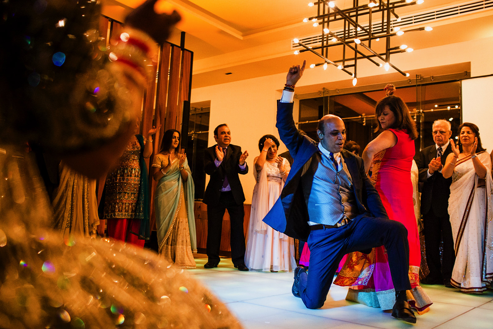 Family performs for groom and bride at hindu wedding reception