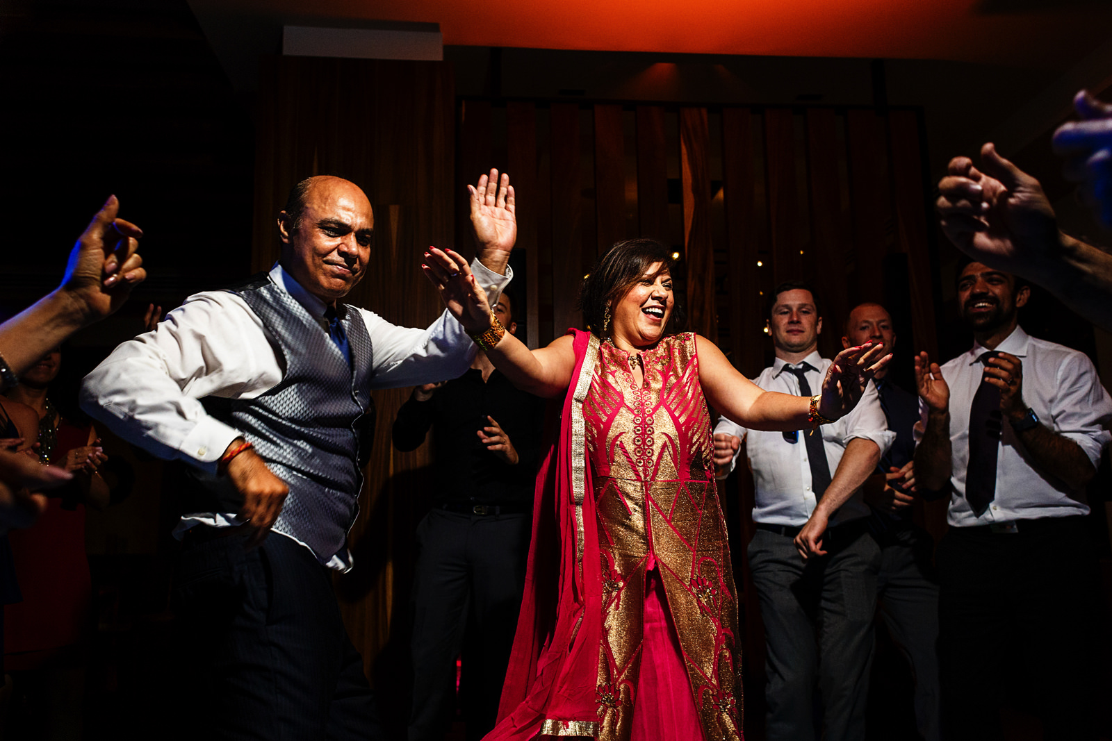 Family and guests dance at the hindu wedding party