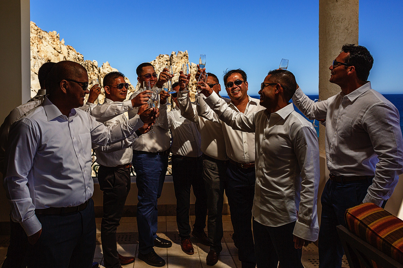 Groom and groomsmen toasting with champagne
