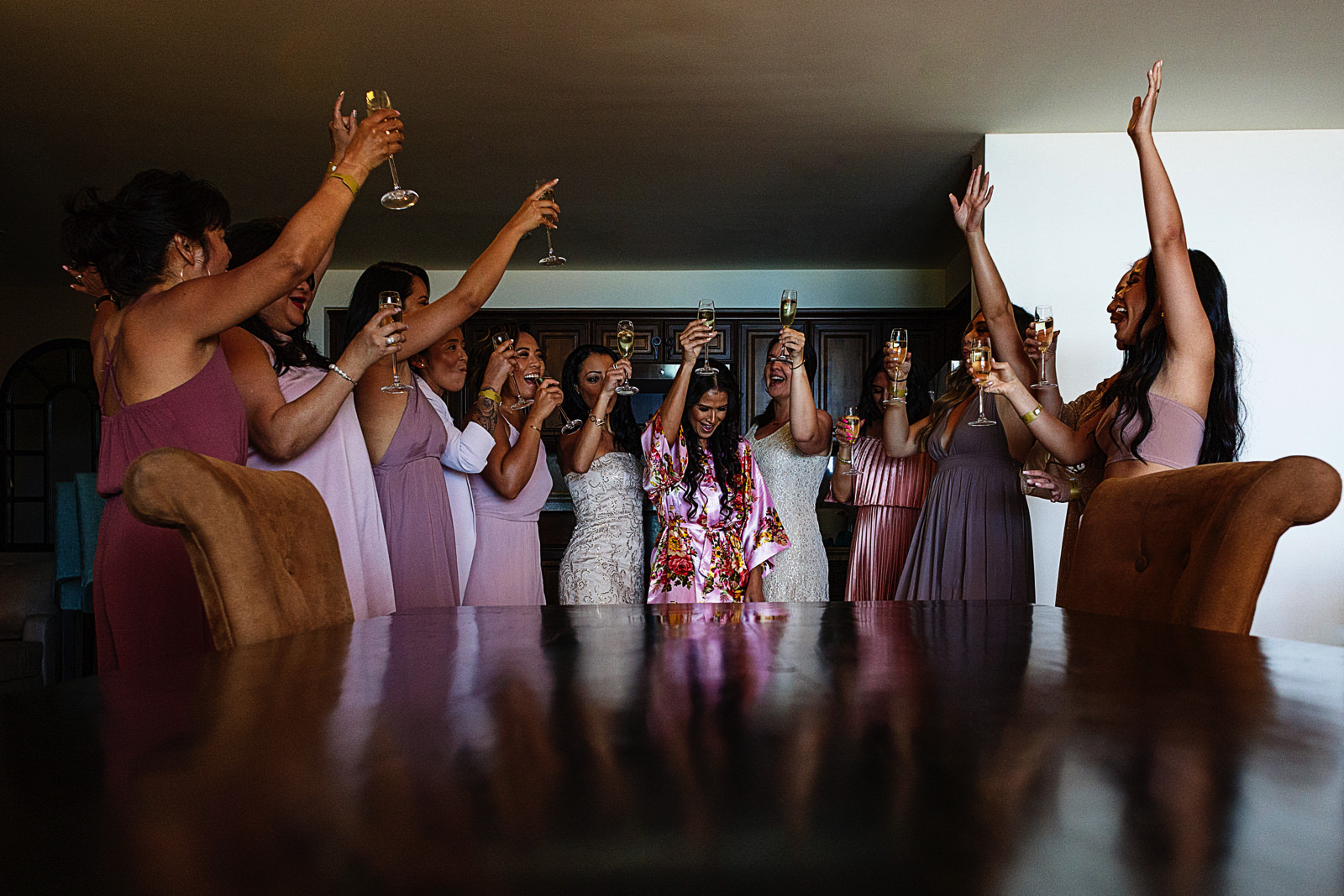 Bride and bridesmaids toasting with champagne at Grand Solmar suite