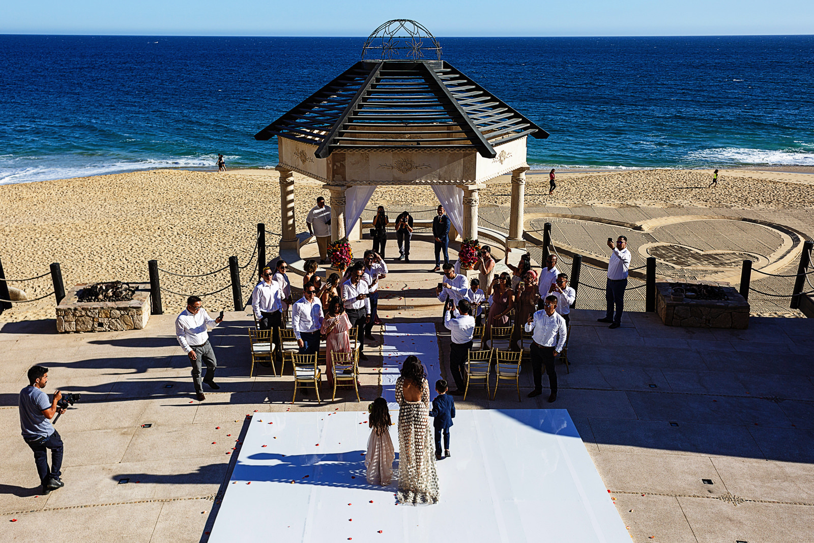 Bride, daughter and son walking down the aisle to begin the wedding ceremony at Grand Solmar in Cabo San Lucas