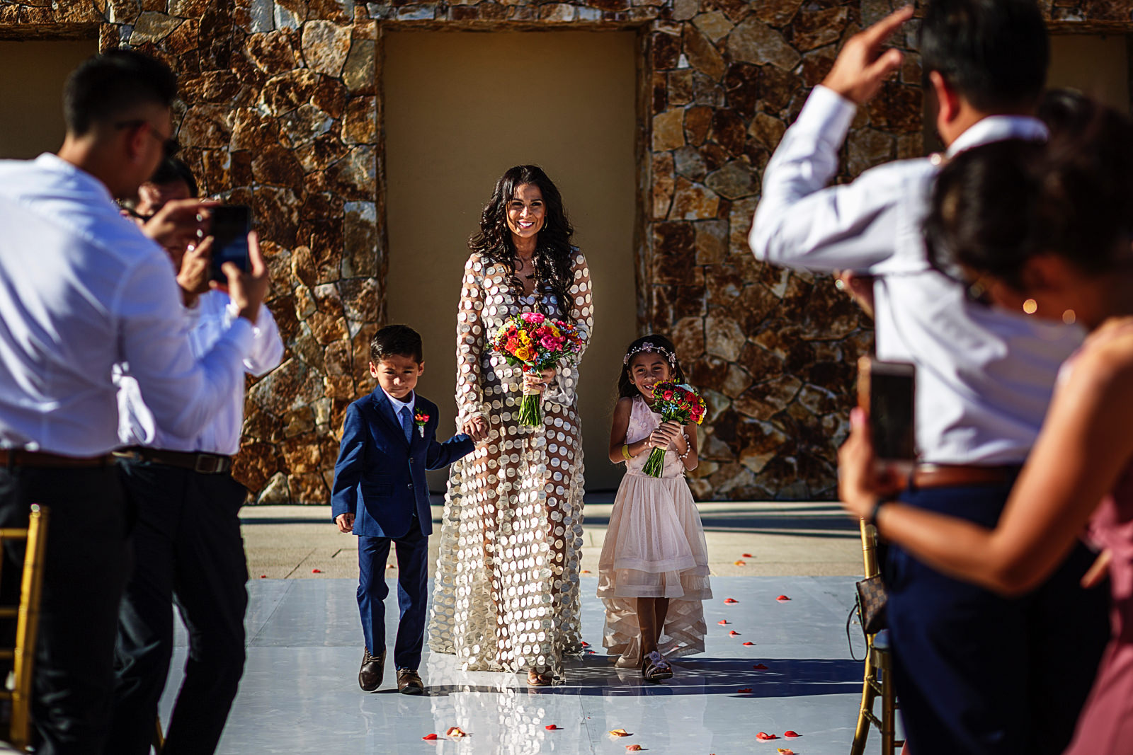 Bride, daughter and son walking down the aisle to begin the wedding ceremony in Cabo San Lucas
