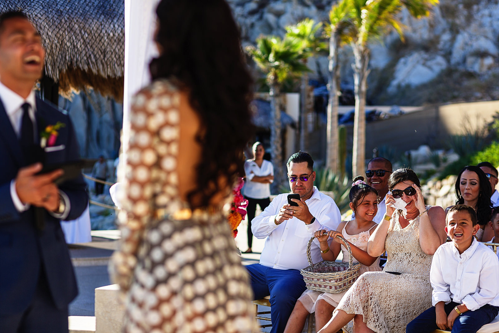 Wedding guests reactions during the destination wedding ceremony in Cabo San Lucas