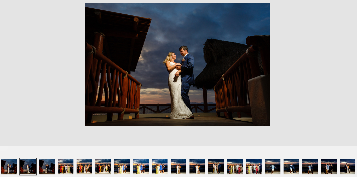 Couple dancing against the sunset at Hotel Playa Fiesta's deck