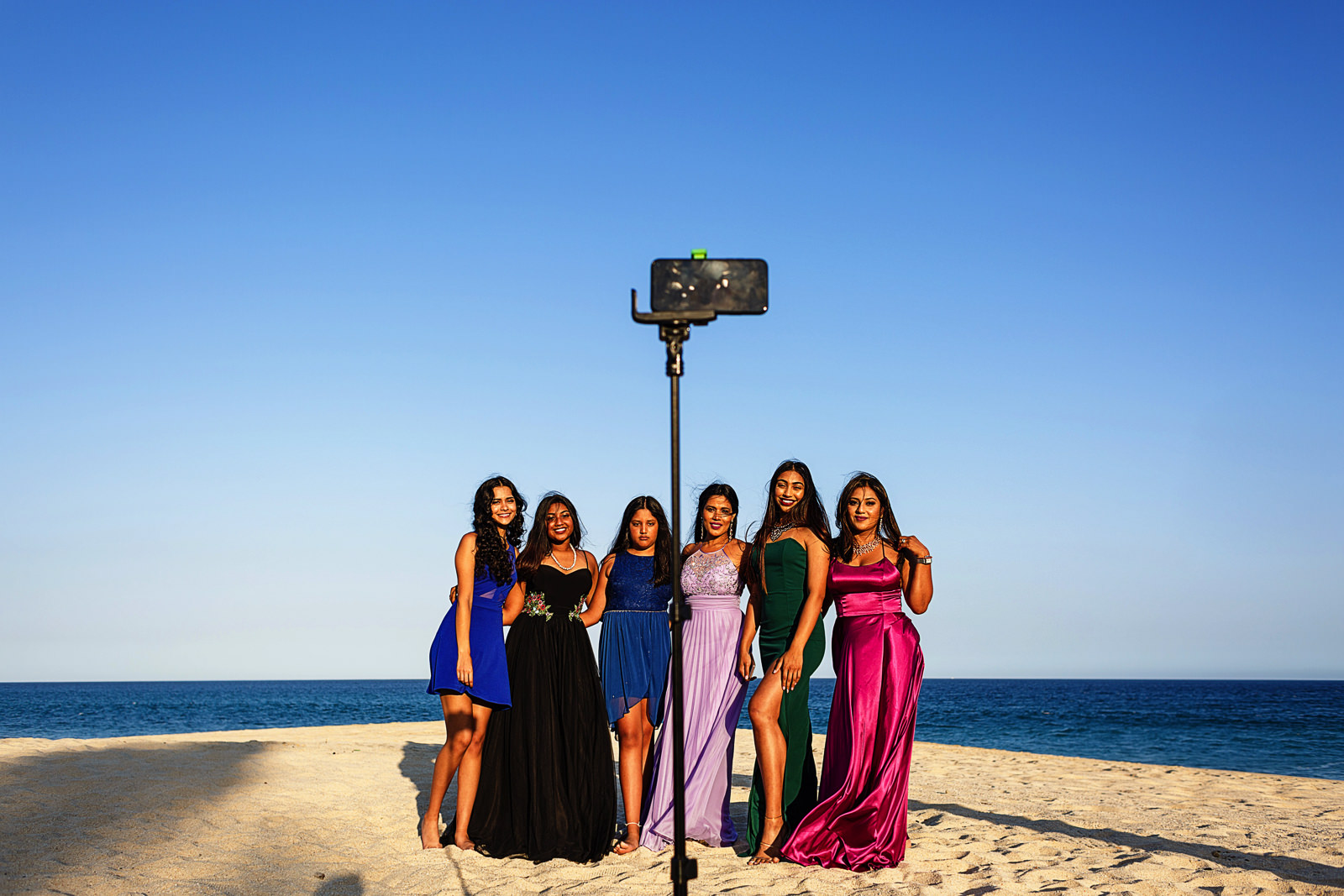 Group of ladies well dressed doing a selfie on the beach