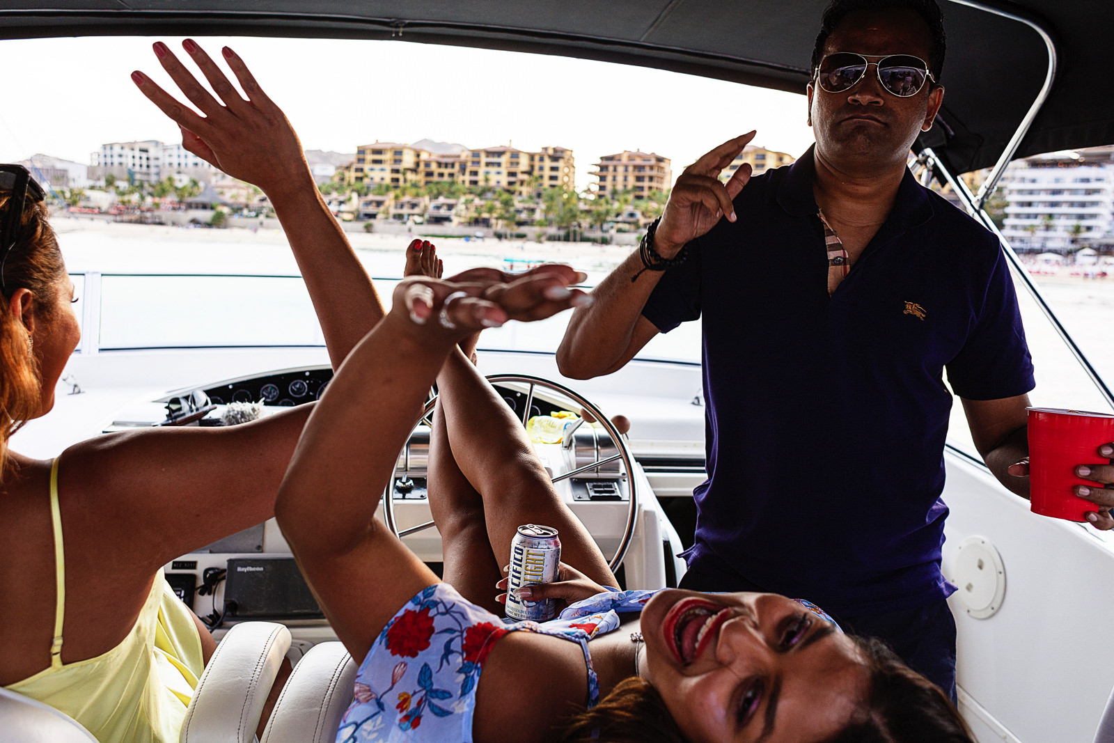 A lady is having fun and steering a yacht with her feet