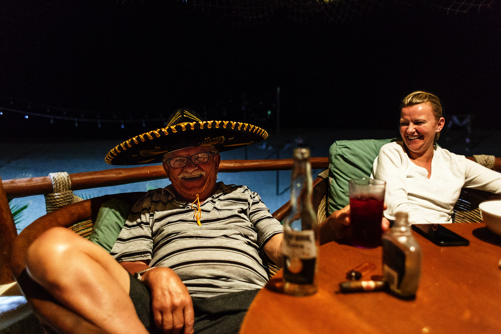 An old european man wears a mexican hat