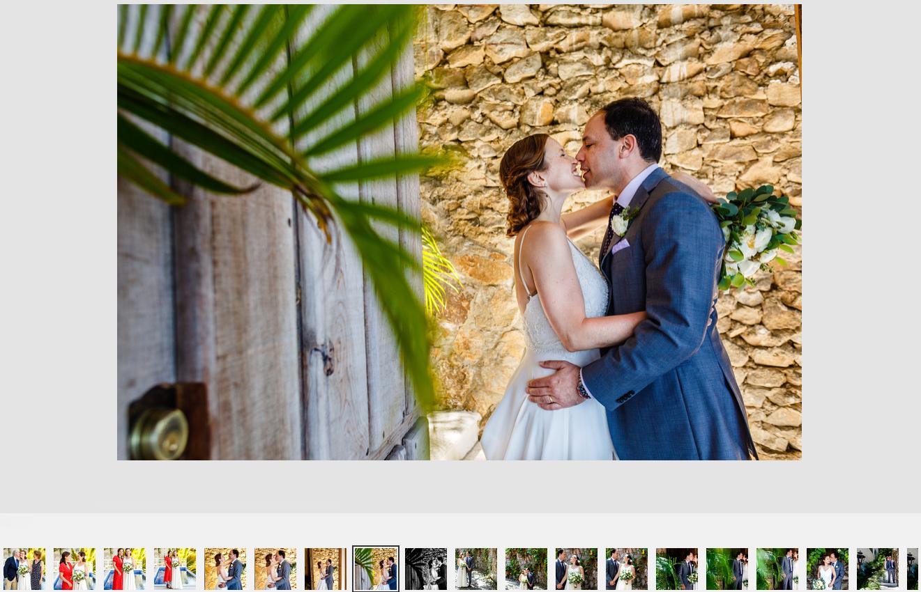 Groom and bride about to kiss seen through a rustic door at Casa Azul Profundo, south of Puerto Vallarta, Mexico.