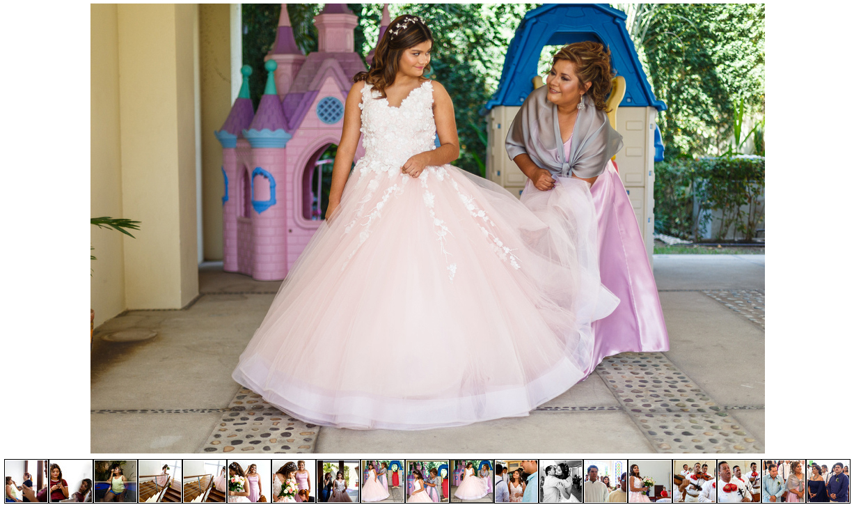 Teenager quinceañera is getting dressed by her mother in front of a princess castle.