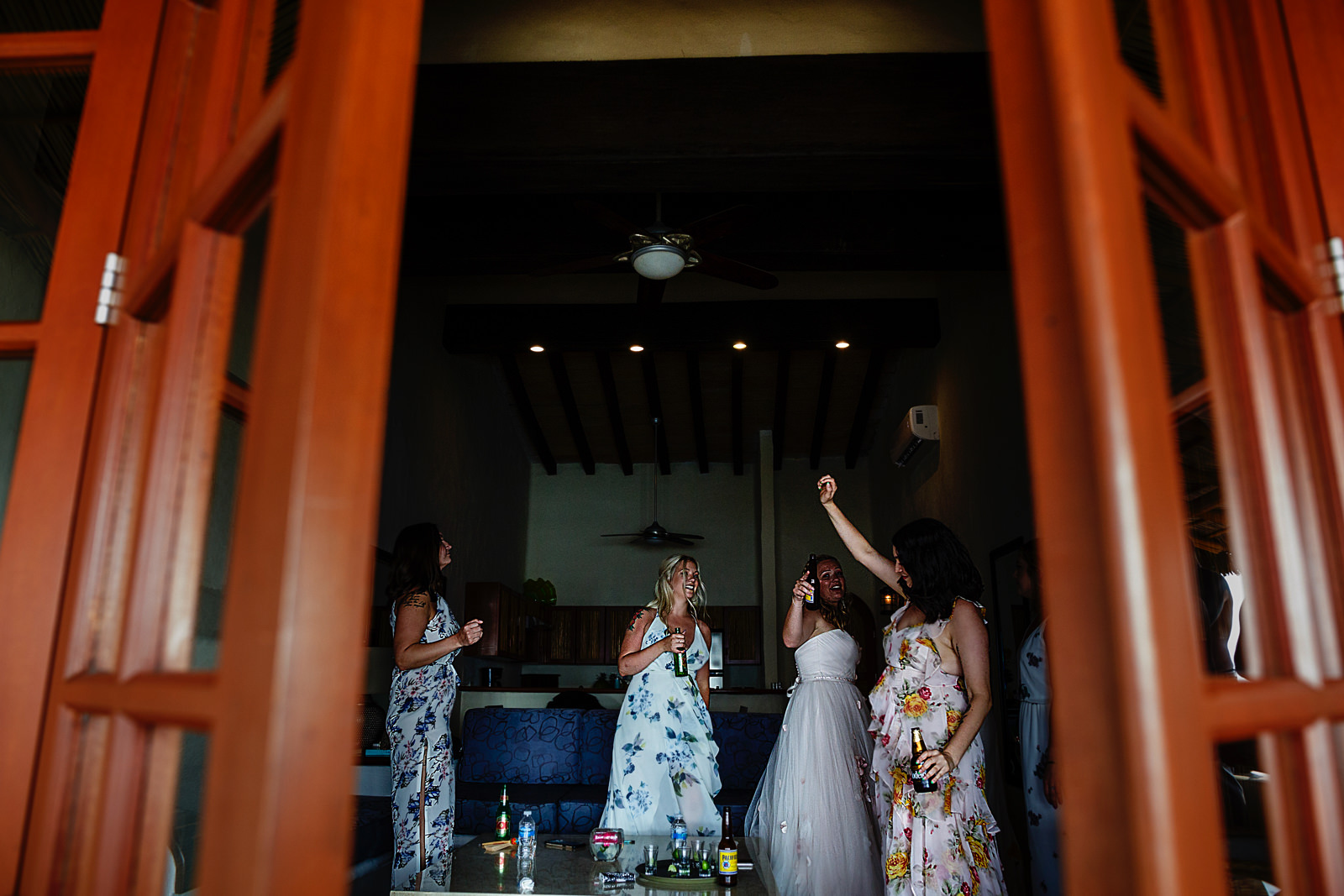 bride-bridesmaids-mess-party-beers-door.jpg