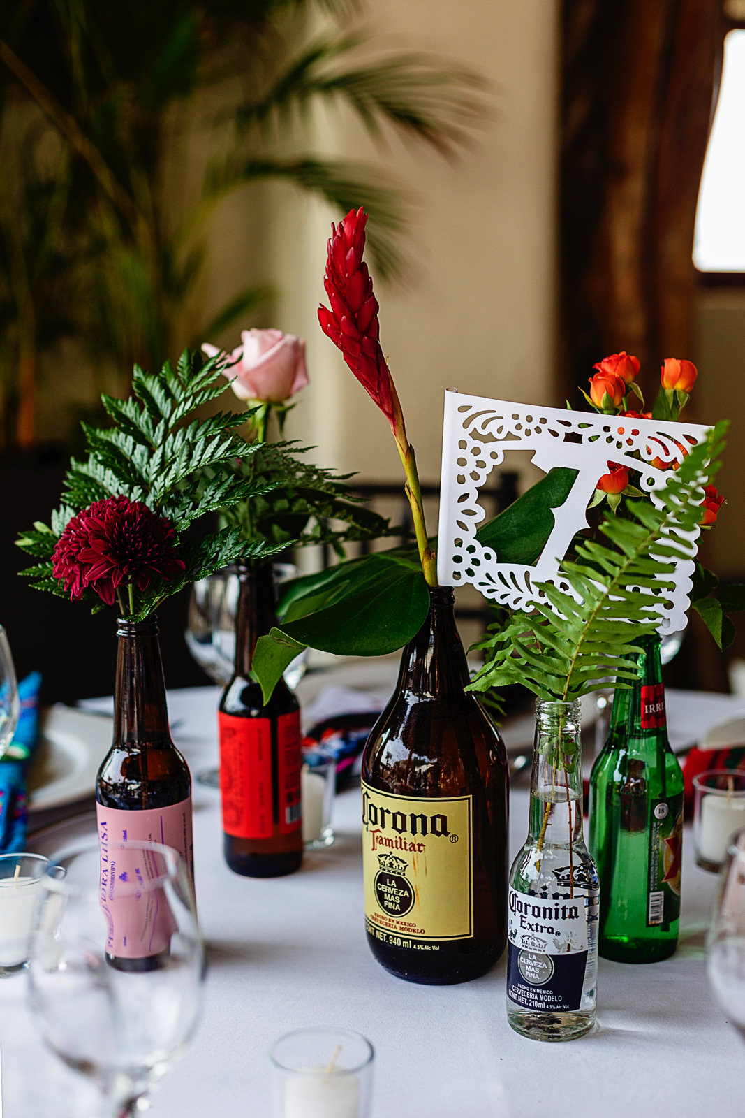 wedding-decorations-beer-bottles-center-pieces-flowers.jpg