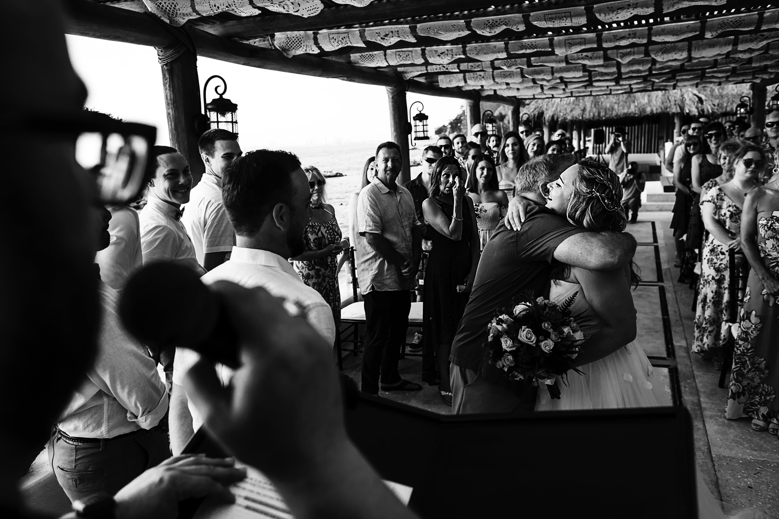 bride-hugs-dad-end-aisle-wedding-ceremony.jpg