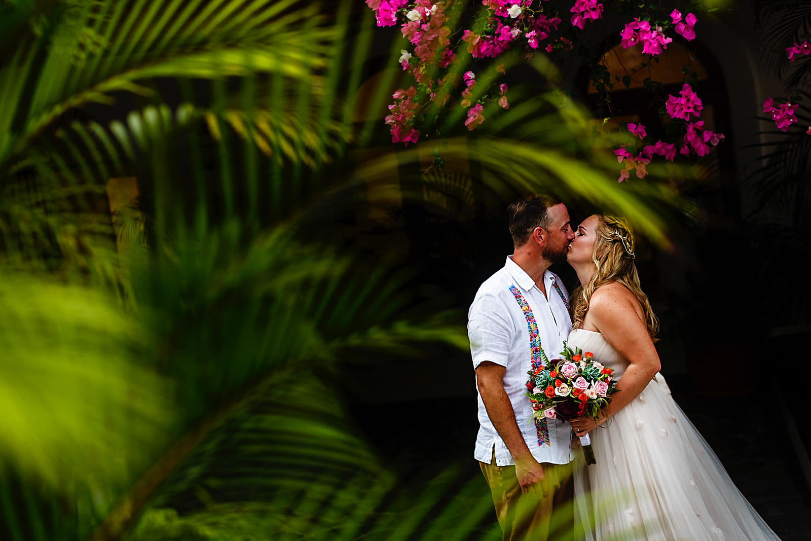 bride-groom-couple-portrait-green-rose-buganvilias-kiss.jpg
