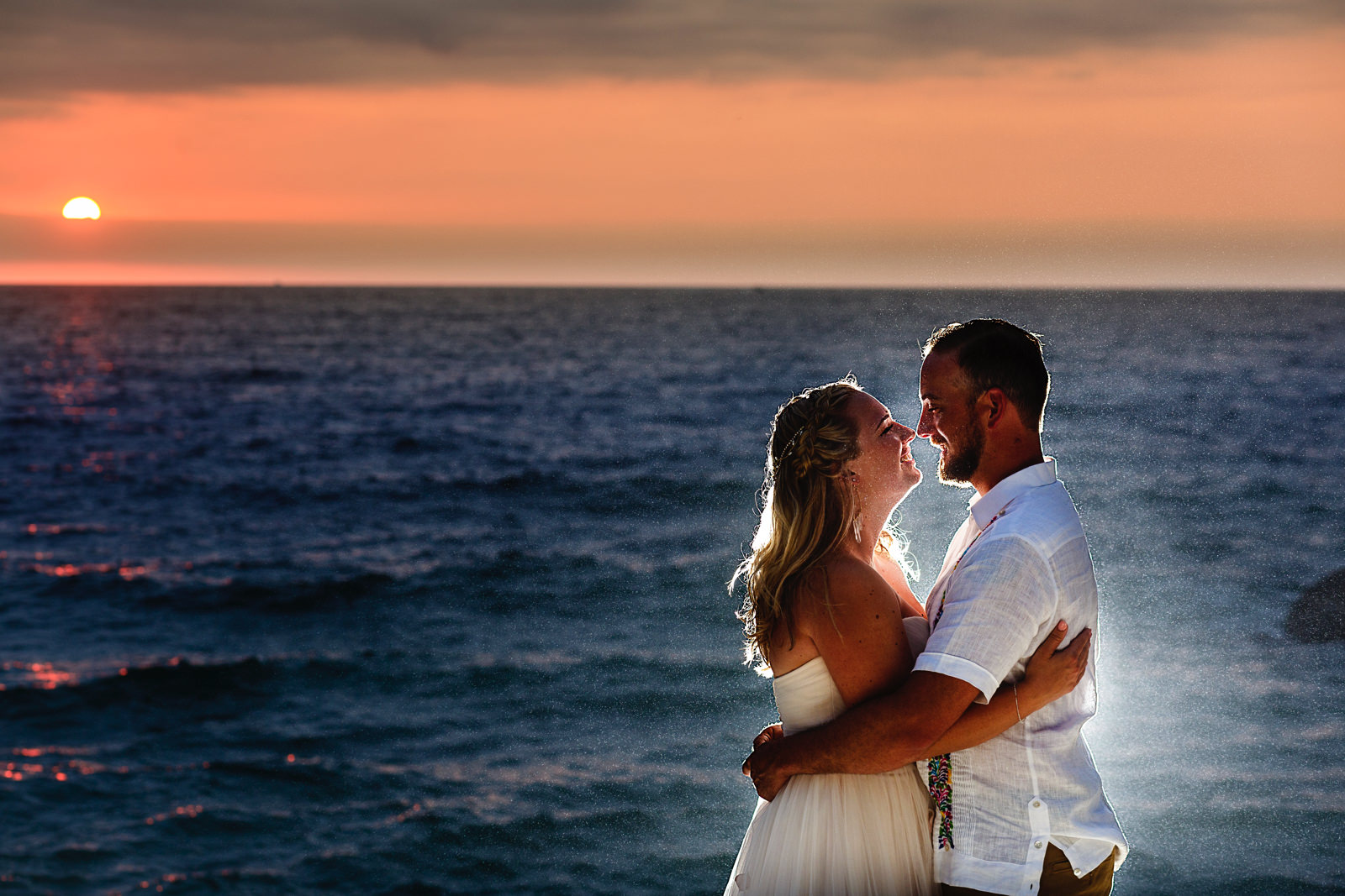 bride-groom-ocean-sunset-backlight-love-wedding.jpg